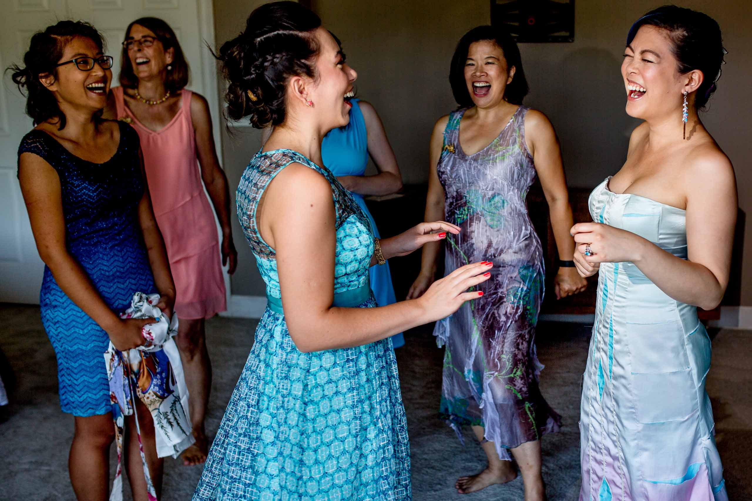 Bride with friends and mother laughing while getting ready for her Portland Chinese Garden elopement