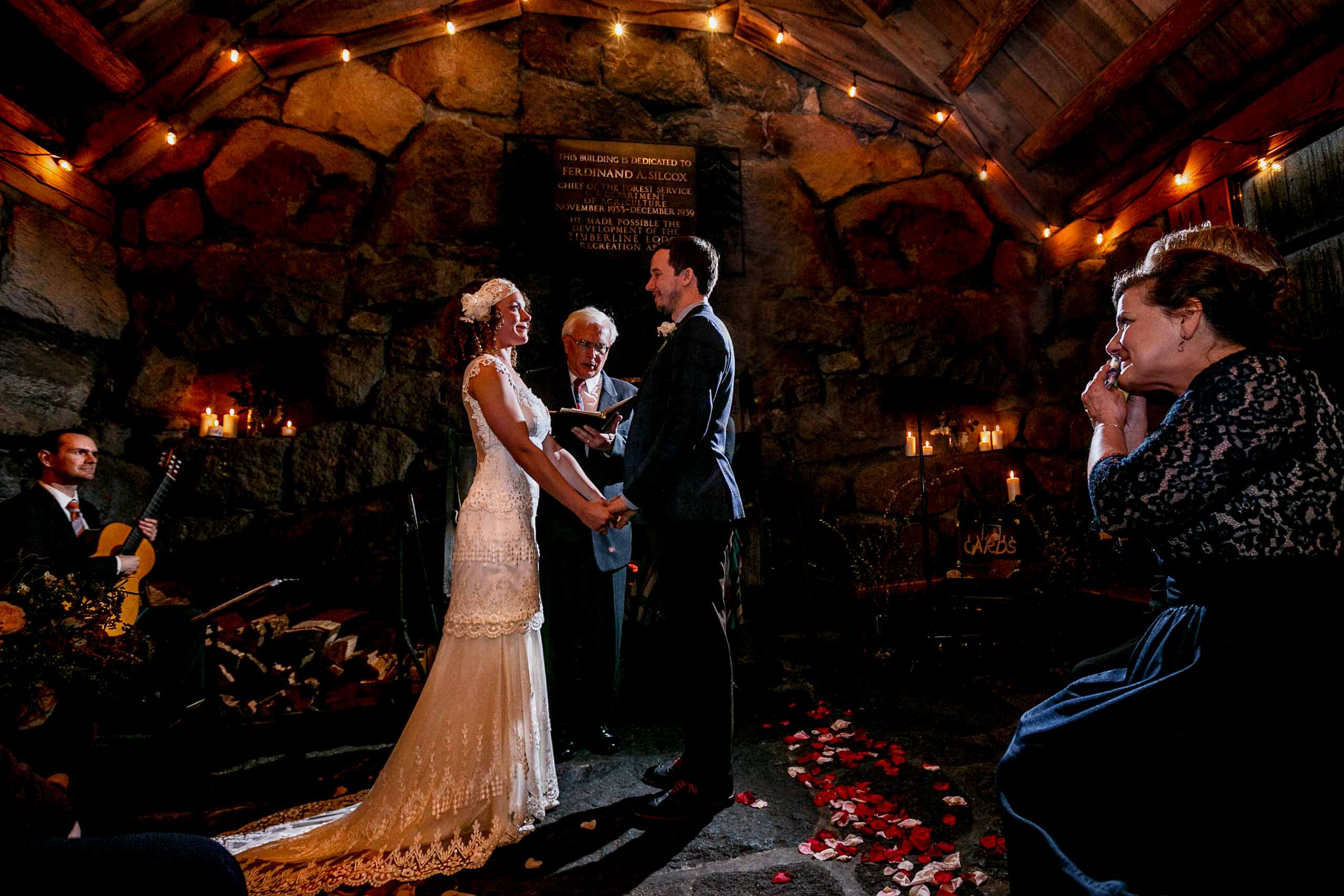 Bride and groom exchanging vows during a Silcox Hut Wedding ceremony above Timberline Lodge on Mt Hood