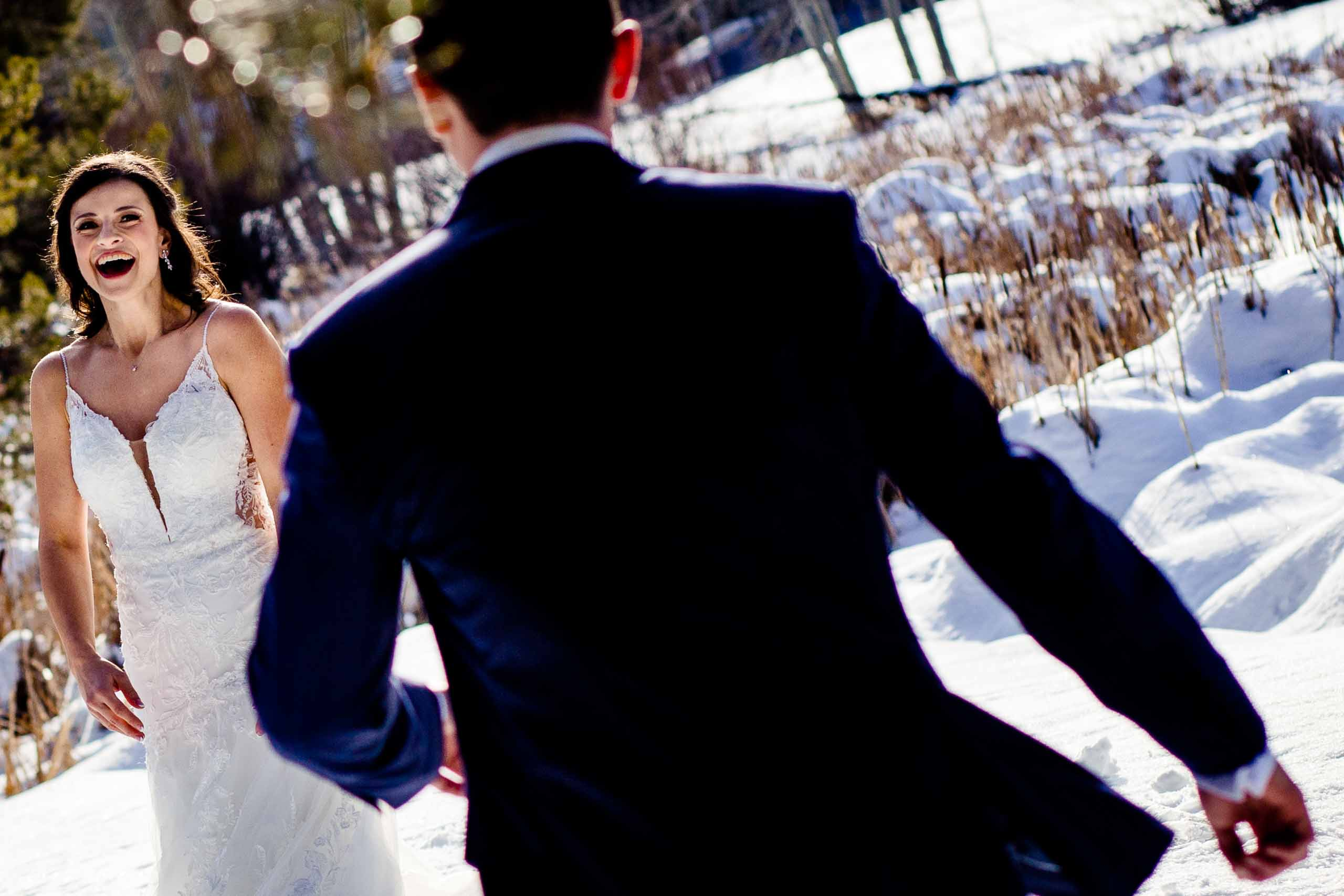 Fantastic fun photo of bride and groom seeing each other for the first time for their Sunriver Resort wedding in Oregon