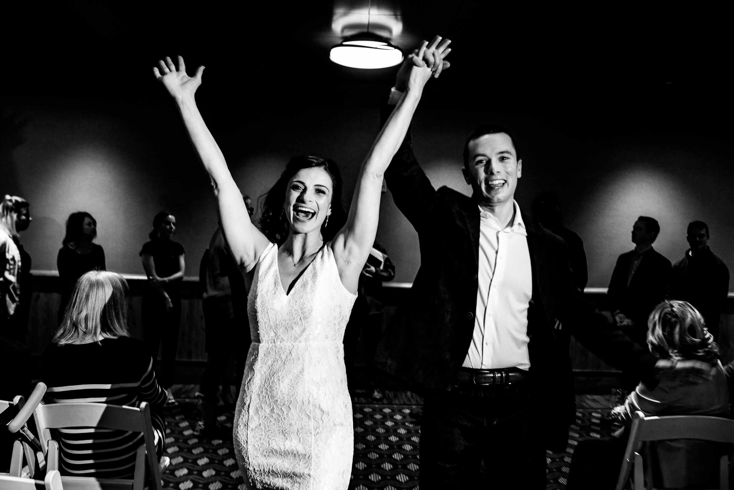Fun rehearsal dinner photo of bride and groom at their Sunriver Resort wedding in Oregon