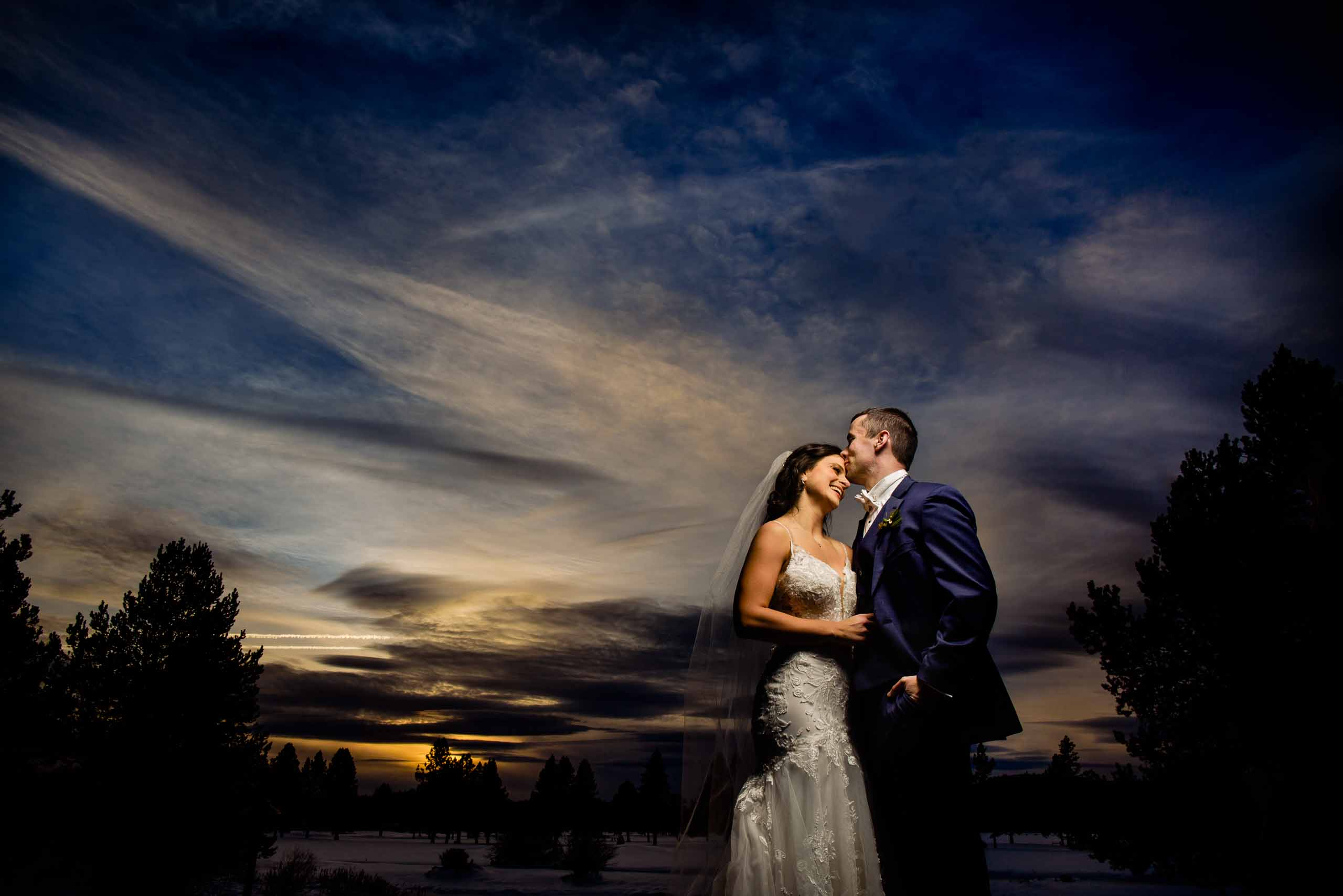 Bride and groom portrait with beautiful light at sunset at Sunriver Resort during their winter wedding