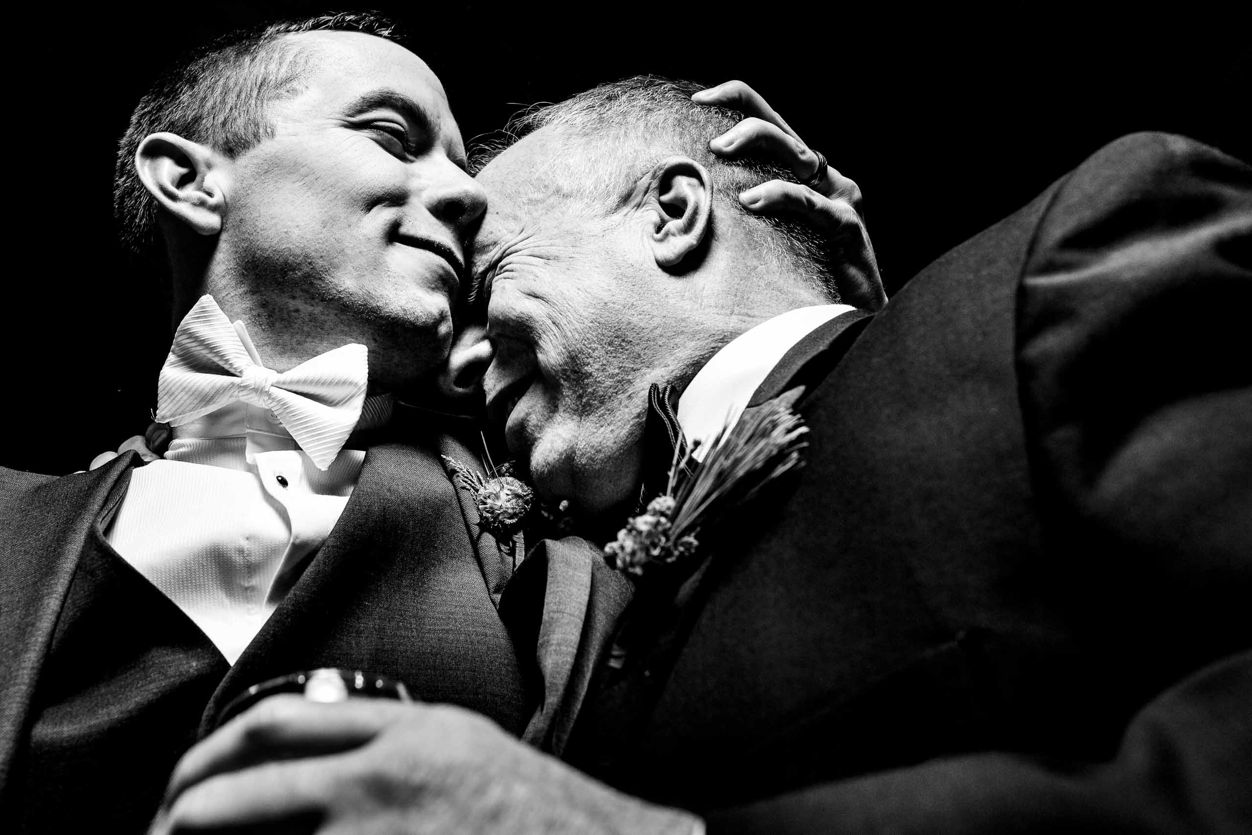Beautifully lit photo of a groom and his father during Sunriver Resort wedding in Oregon