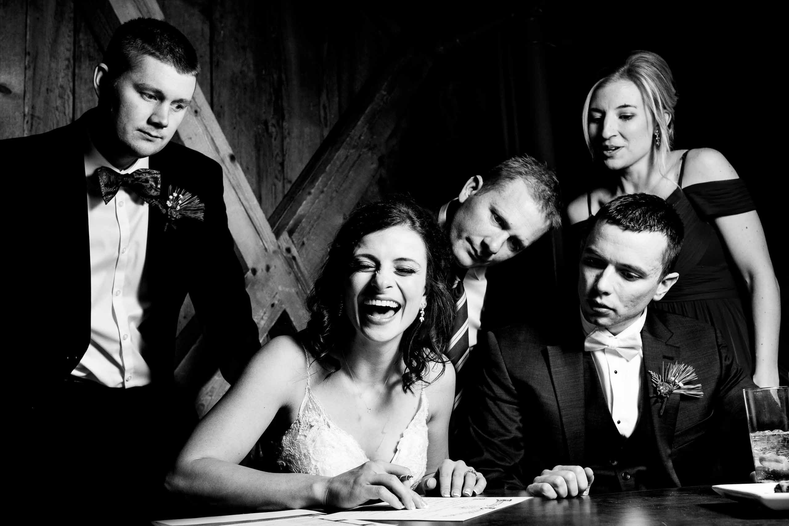 Fun photo of bride and groom signing wedding certificate during their Sunriver Resort Wedding in Oregon