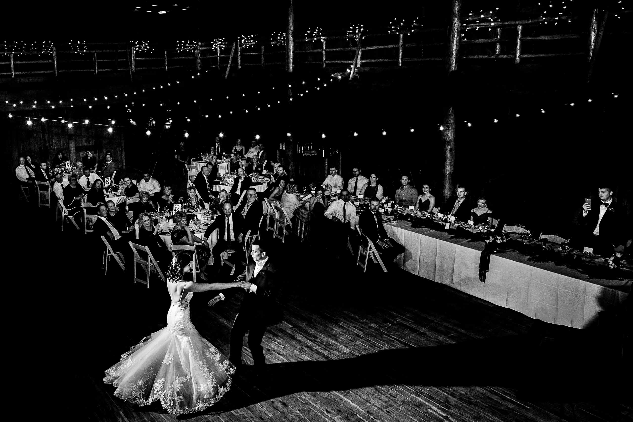 Beautifully lit photo of a bride and groom dancing during their Sunriver Resort wedding reception in Oregon