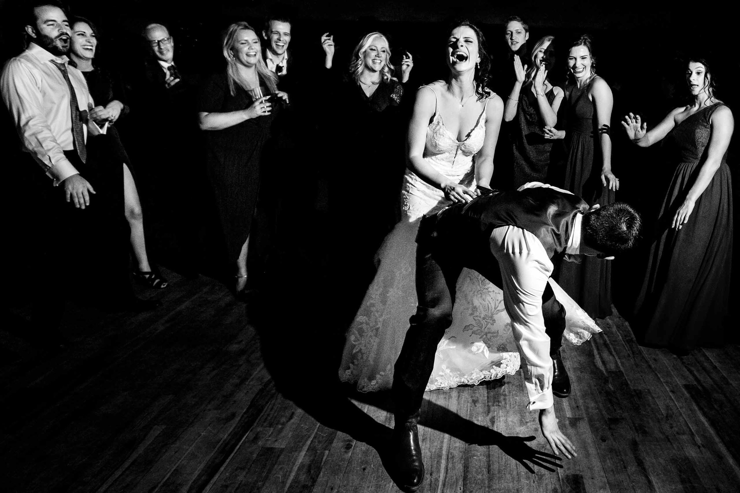Super fun photo of a bride and groom dancing during their Sunriver Resort wedding reception in Oregon