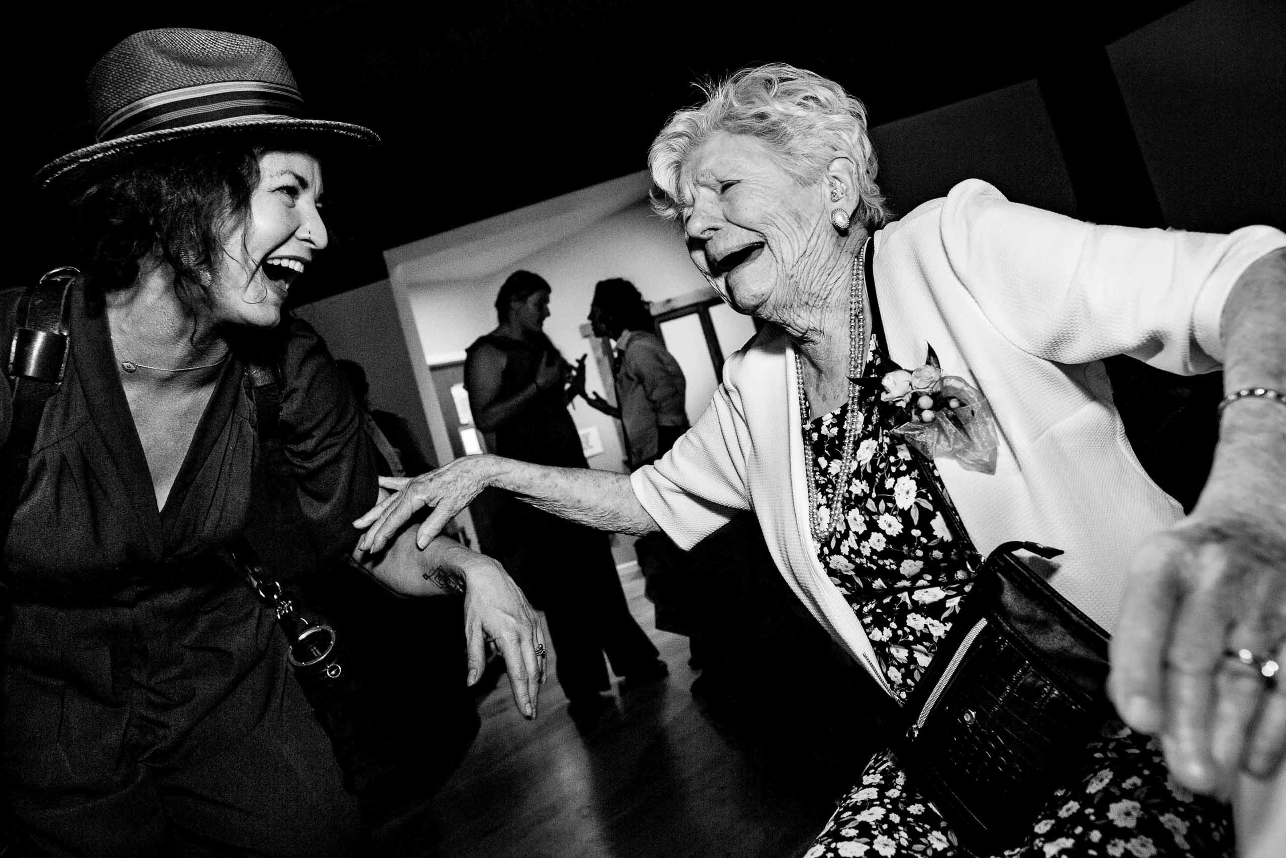 Tree WoodSmith laughing with grandma at wedding josandtree