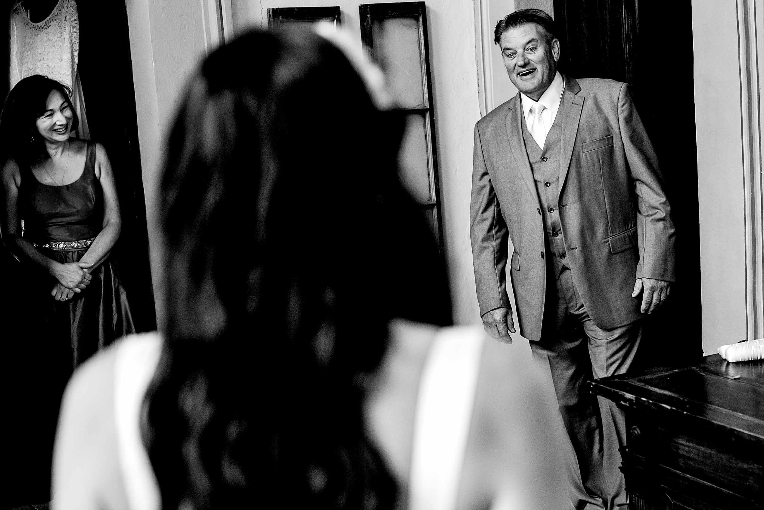 Father seeing bride for the first time moments before a Villa Tre Grazie wedding ceremony inside the building.