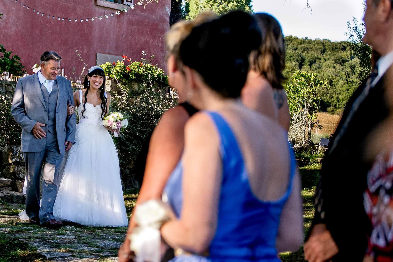 Bride walking into her Villa Tre Grazie wedding ceremony near Todi, Italy in Umbria.