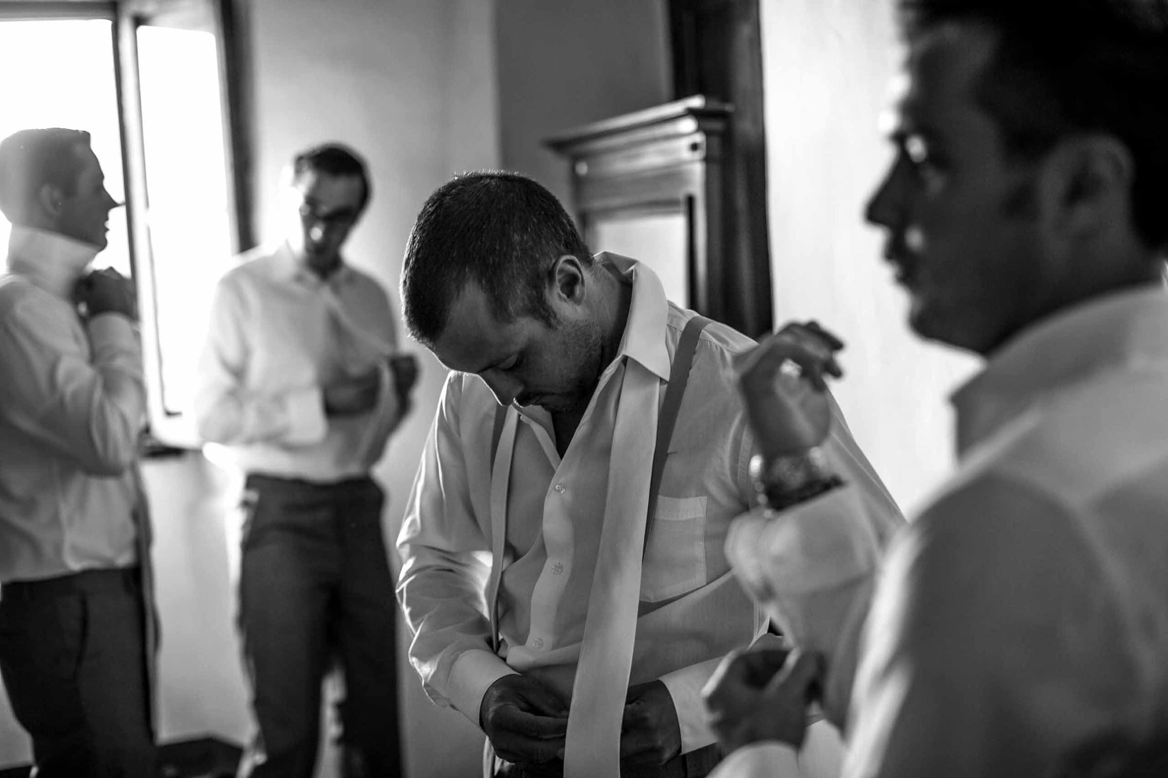 Groomsmen getting ready for a Villa Tre Grazie Wedding in Umbria near Todi, Italy.
