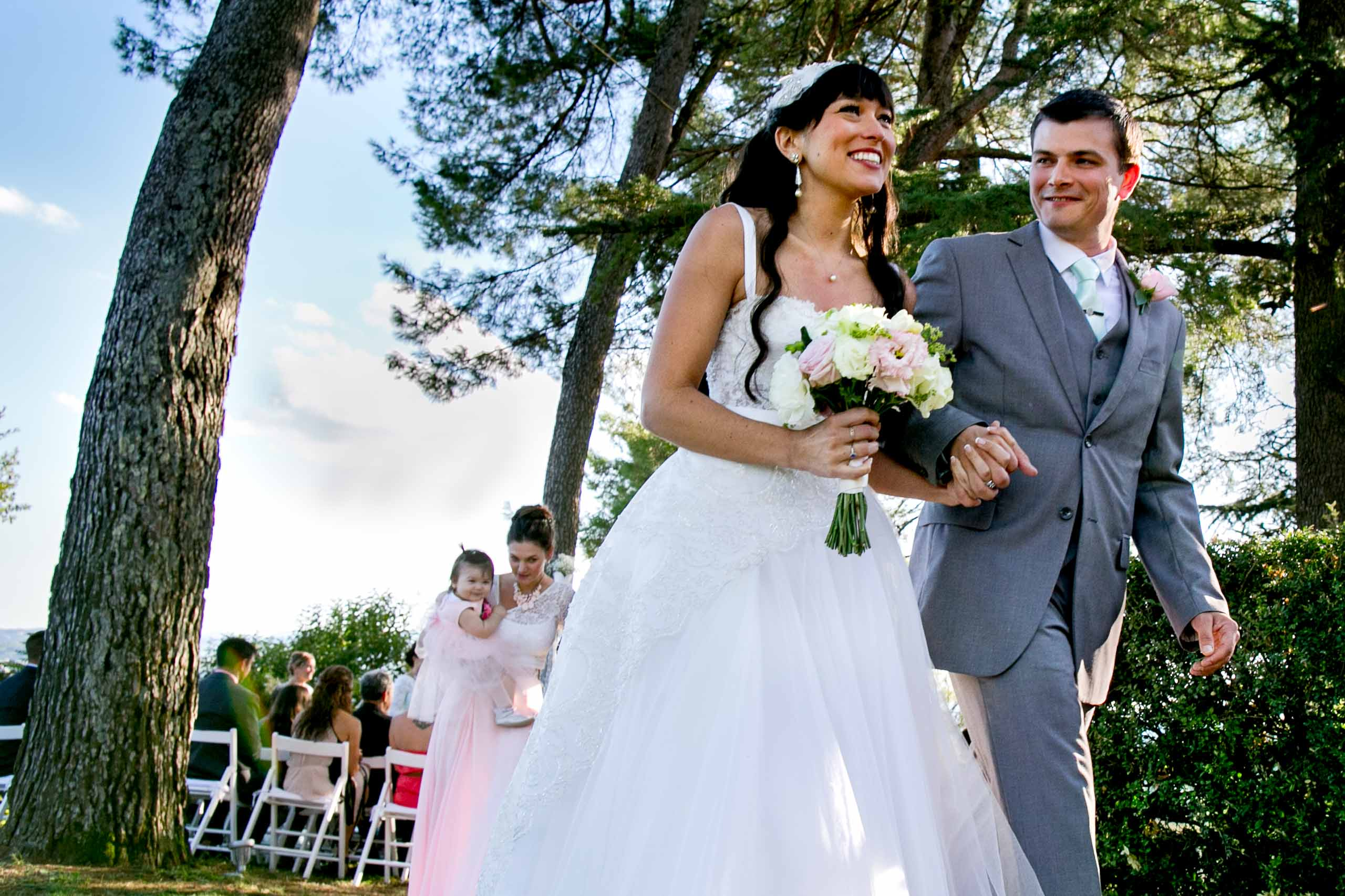 Bride and groom exiting their Villa Tre Grazie wedding ceremony near Todi, Italy in Umbria.