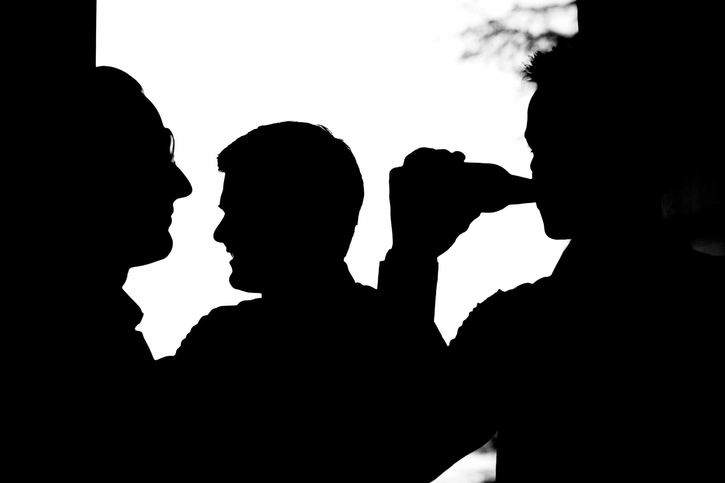 Silhouette photos of groosmen having fun while getting ready for a Villa Tre Grazie Wedding in Umbria near Todi, Italy.