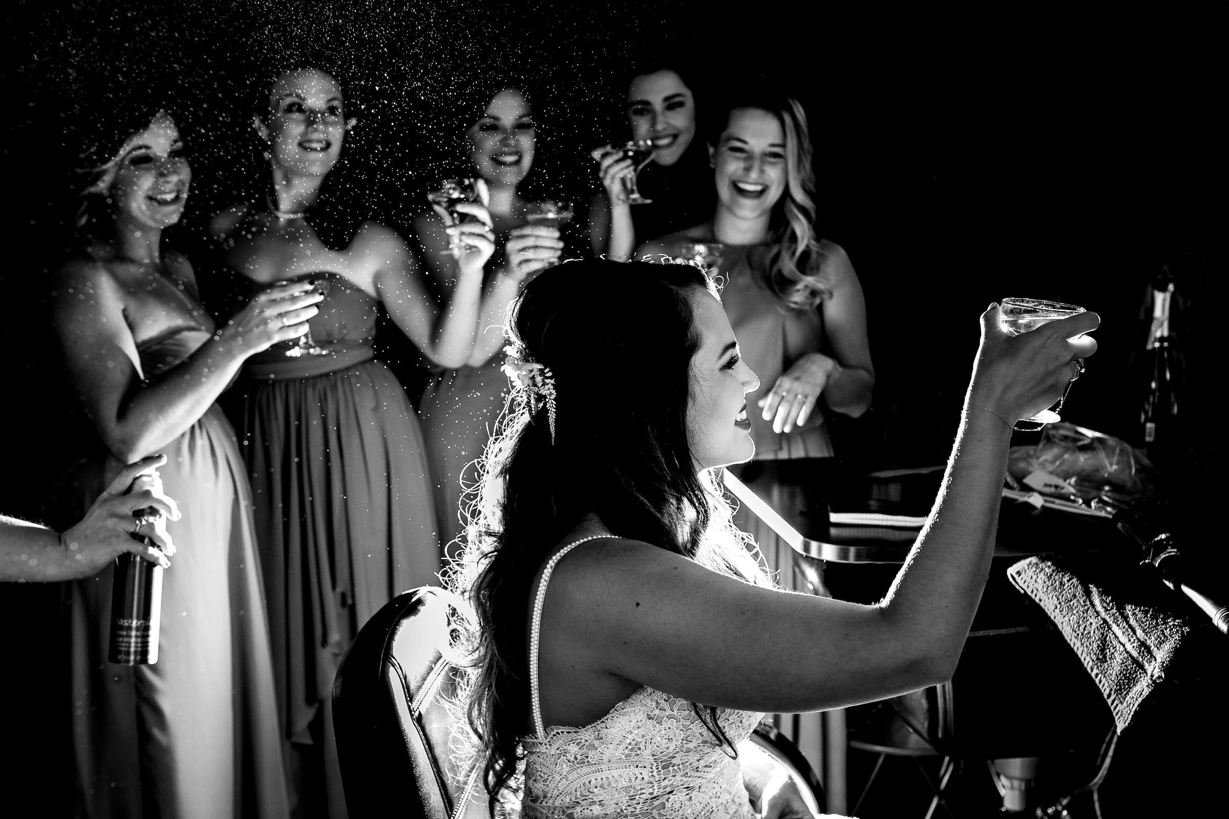 Candid photo of a bride getting ready with close friends before her Ohana Barn wedding in Corvallis, Oregon