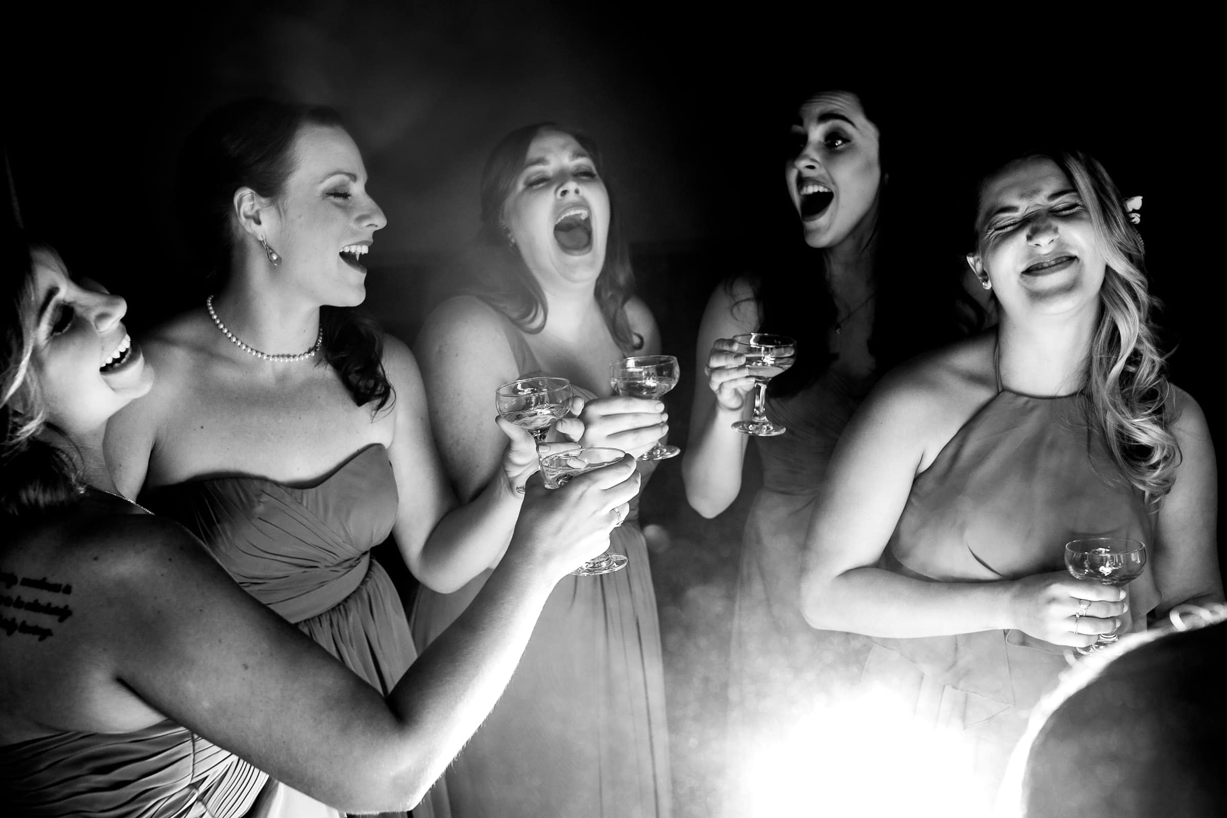 Candid photo of a bride toasting with close friends before her Ohana Barn wedding in Corvallis, Oregon