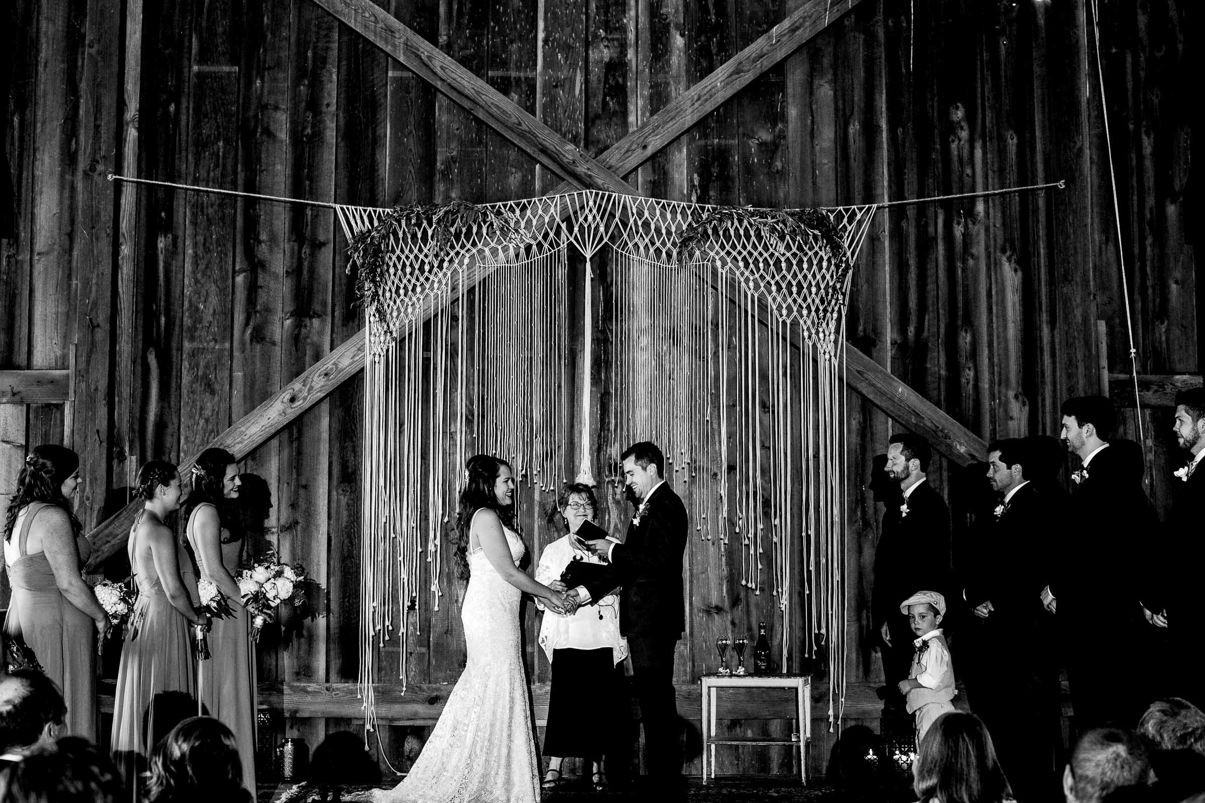 Bride and groom exchanging vows during their Ohana Barn wedding ceremony in Corvallis, Oregon