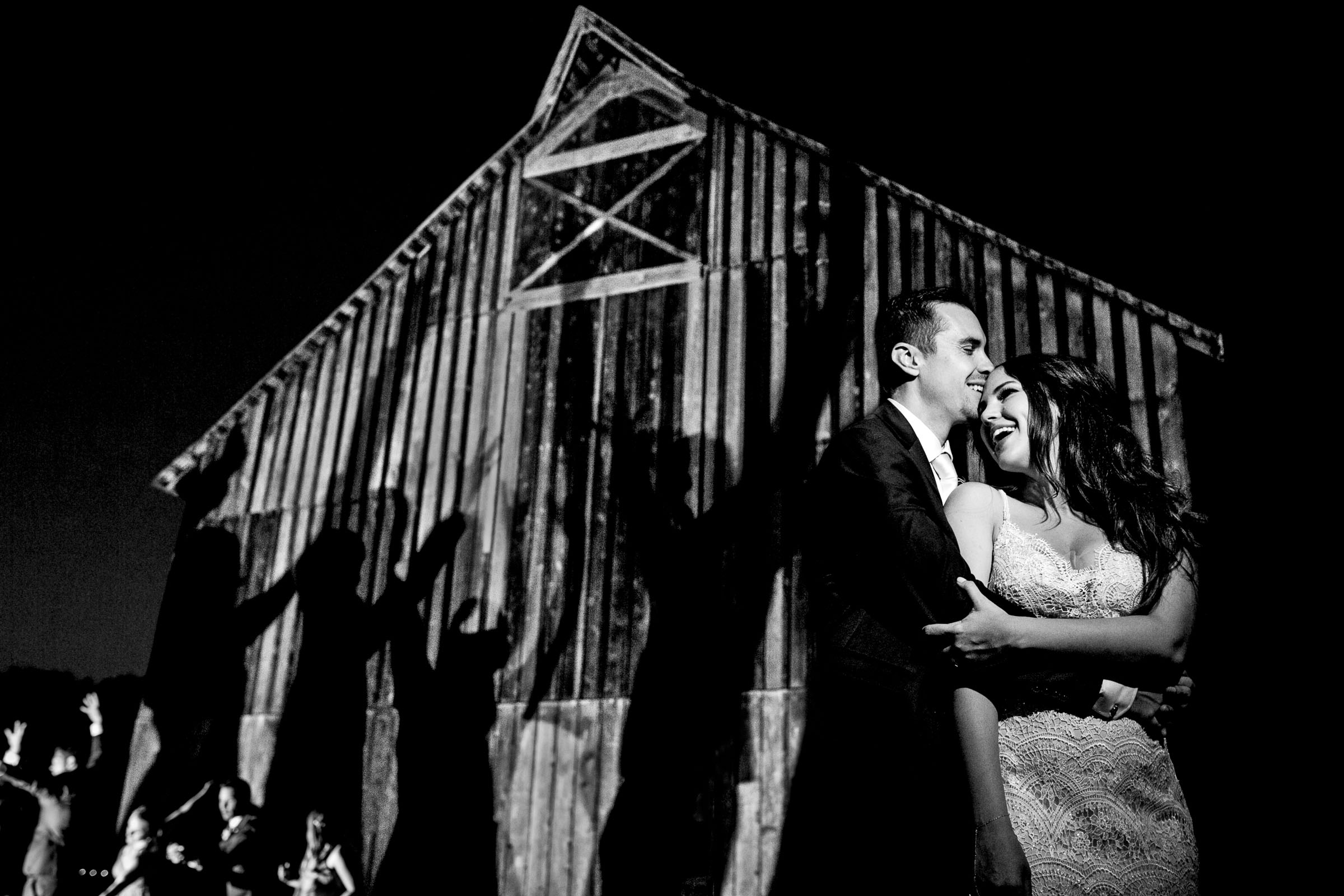 Creative night portrait of bride and groom during their Ohana Barn wedding