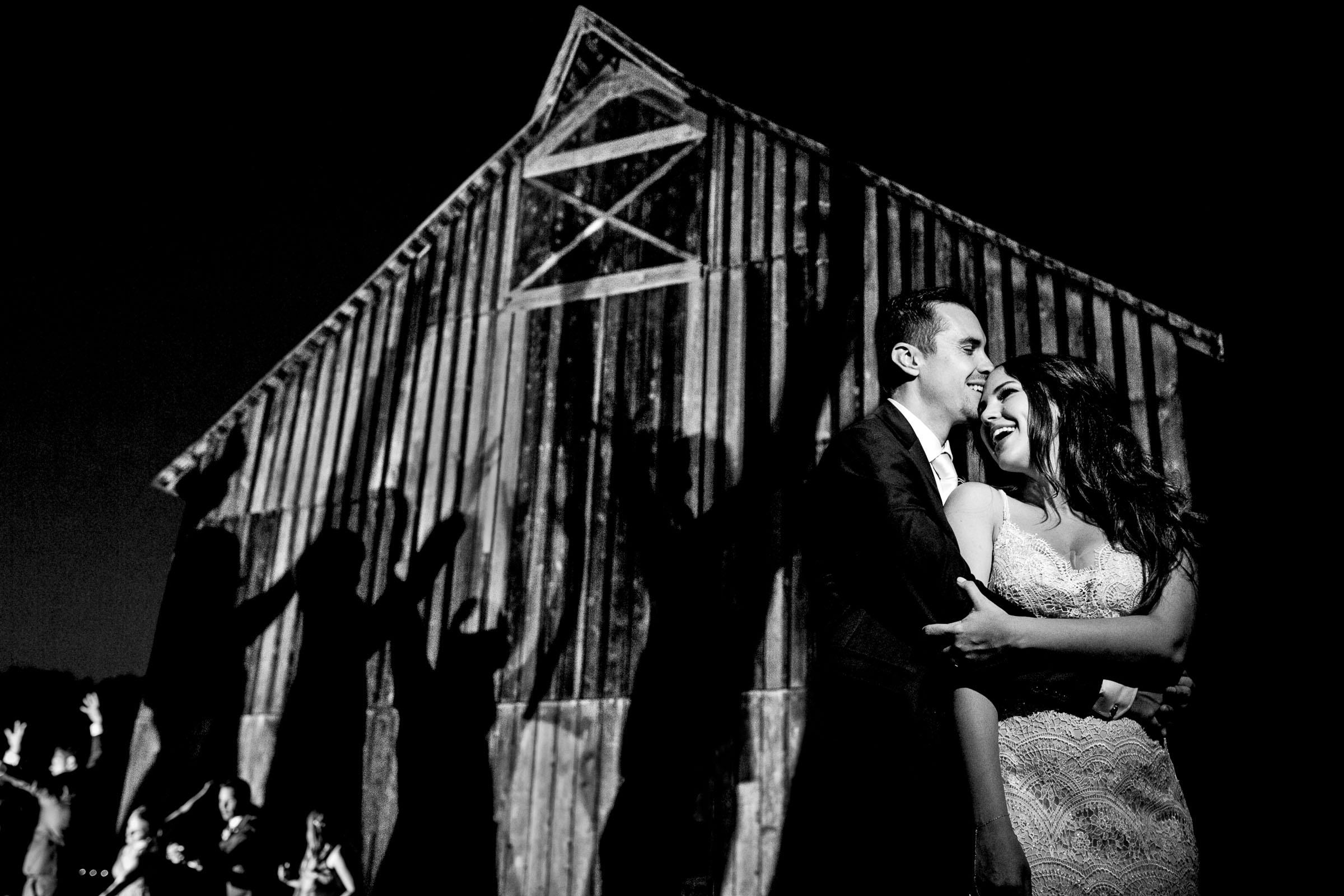 Creative night portrait of bride and groom during their Ohana Barn wedding