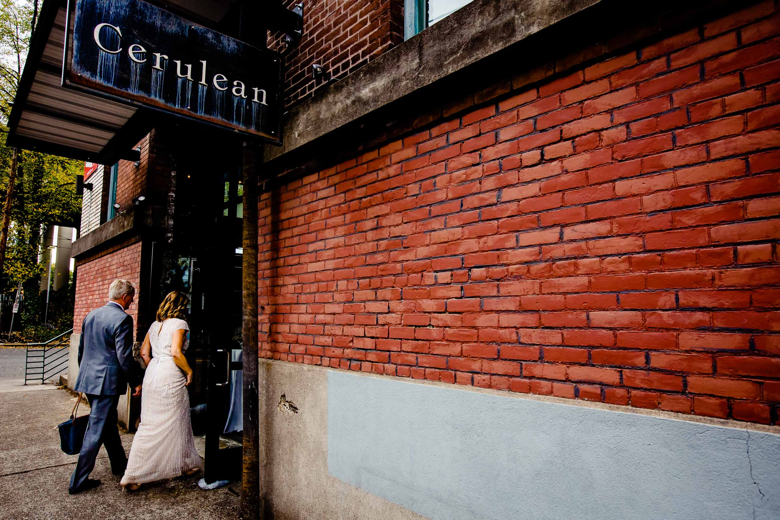 Bride and Groom heading into their small Portland Wedding at the Cerulean Wine bar
