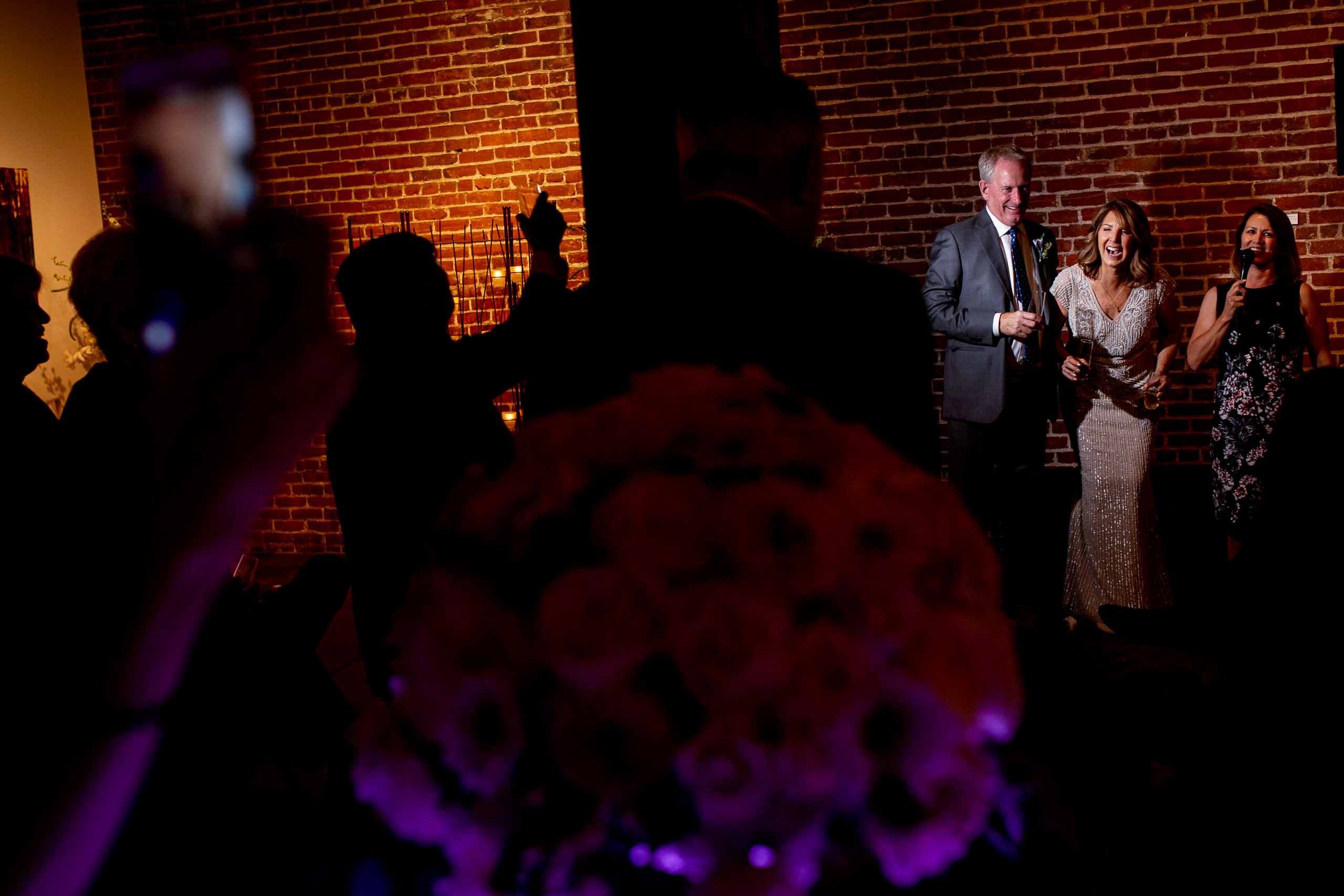 Bride and groom laughing during speeches at their small Portland Wedding at the Cerulean Wine bar