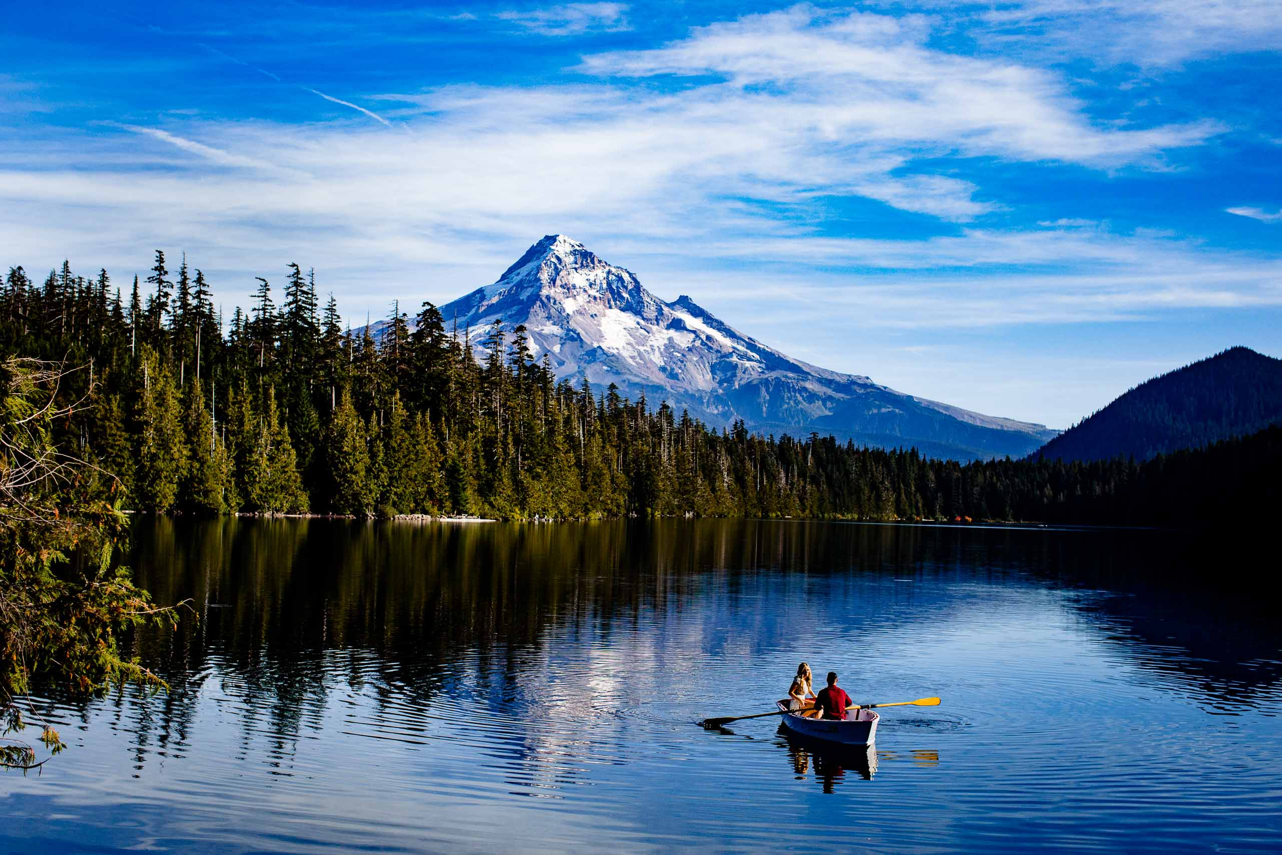 A beautiful boat ride for a gorgeous couple during their Lost Lake engagement photos near Sisters Oregon.