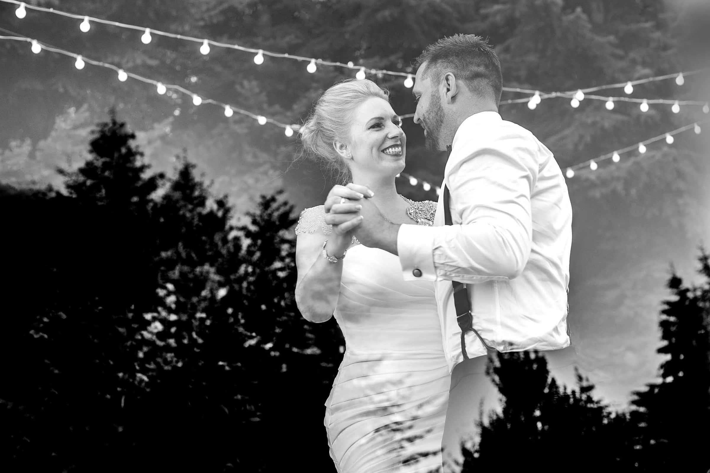 Gorgeous bride and groom creative first dance photo at Gorge Crest wedding venue.