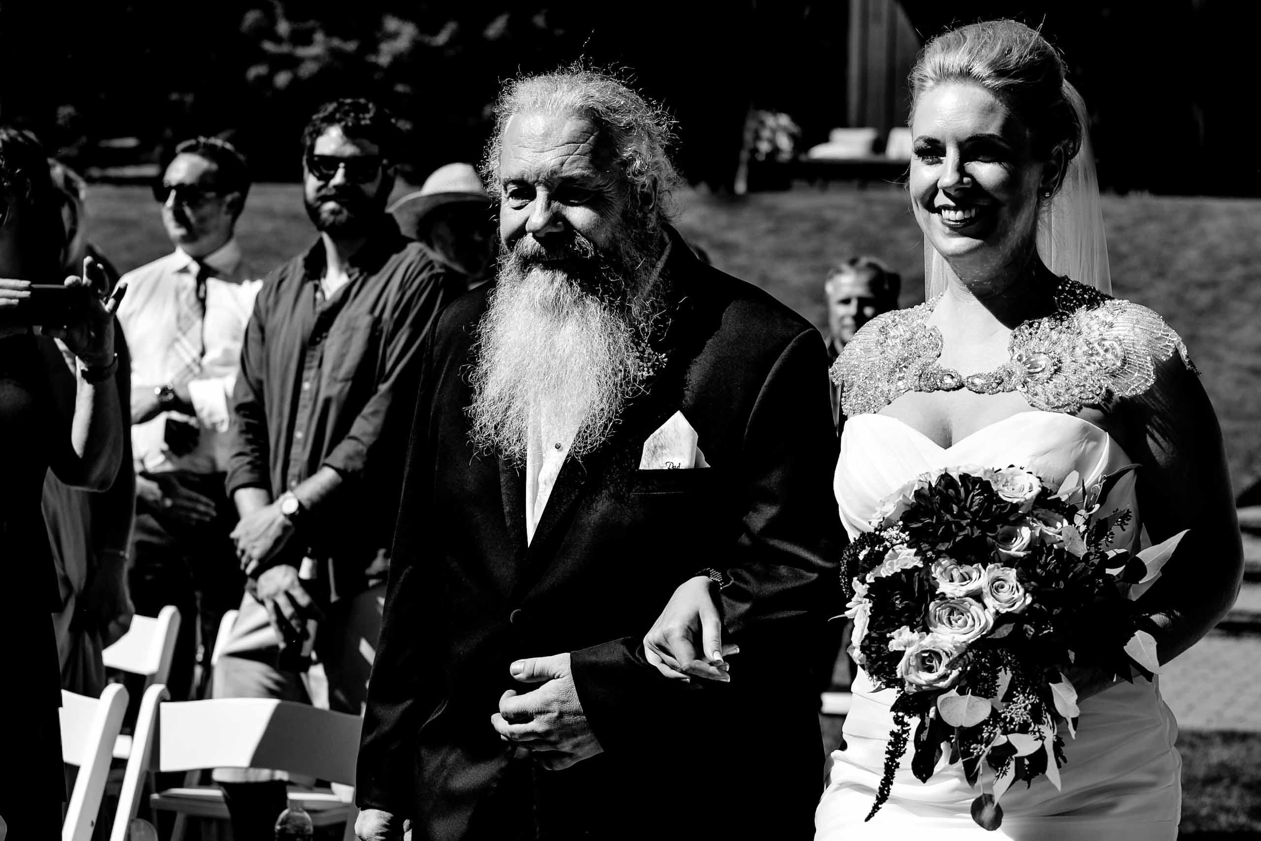 Father walking bride into ceremony at Gorge Crest wedding venue near Hood River just outside Portland, Oregon.