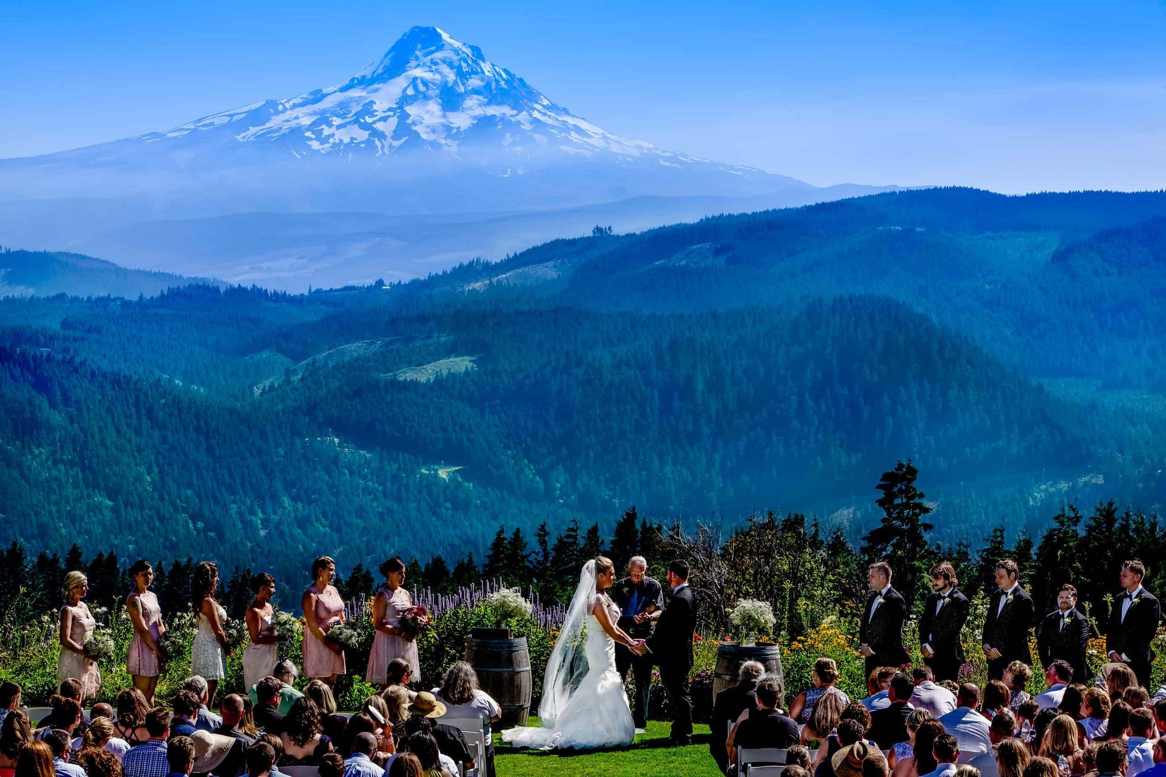 Bride and Groom exchanging vows at a Gorge Crest wedding in the Columbia Gorge near Hood River just outside Portland Oregon with Mt Hood in the backdrop