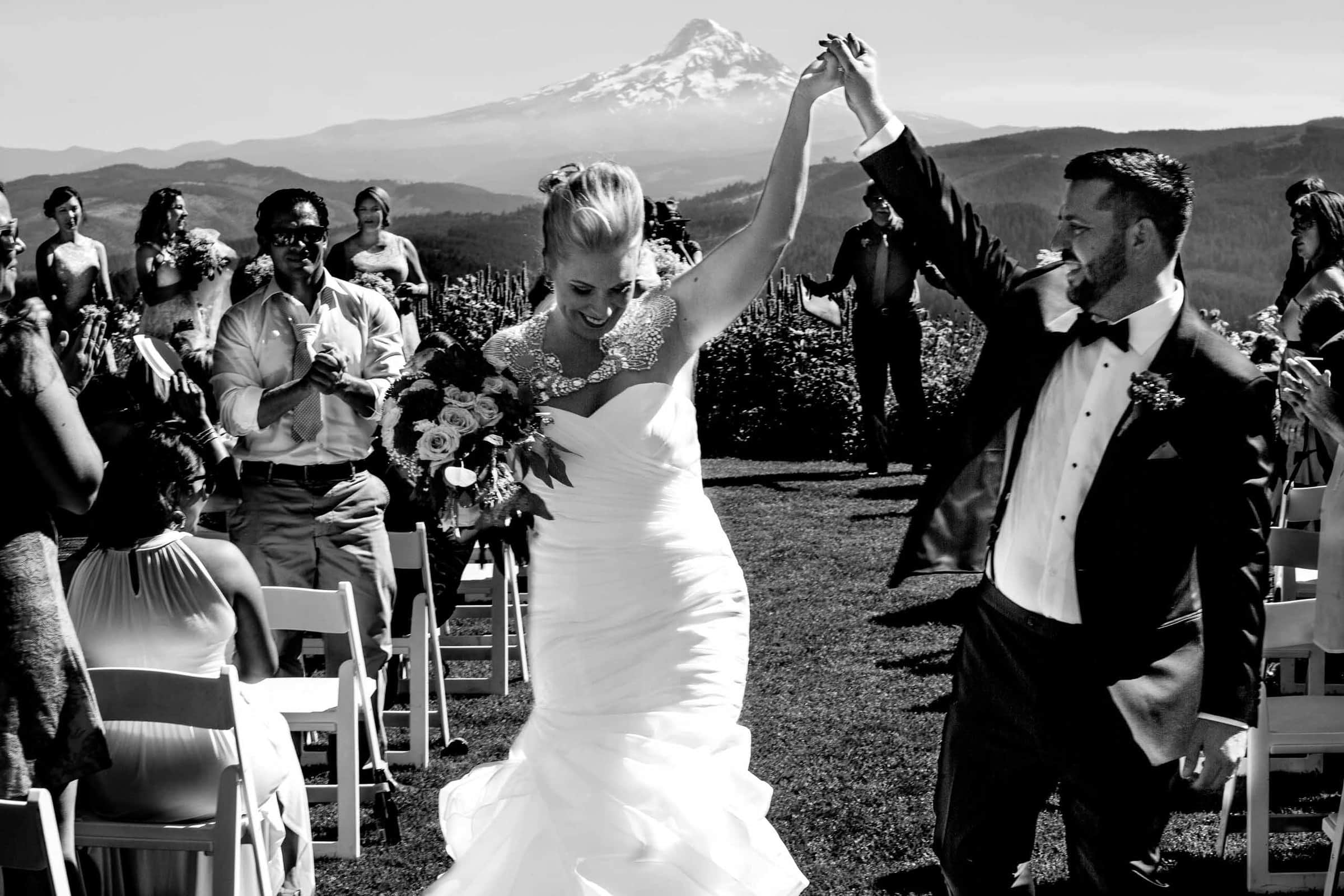 Bride and Groom exiting their Gorge Crest wedding in the Columbia Gorge near Hood River just outside Portland Oregon