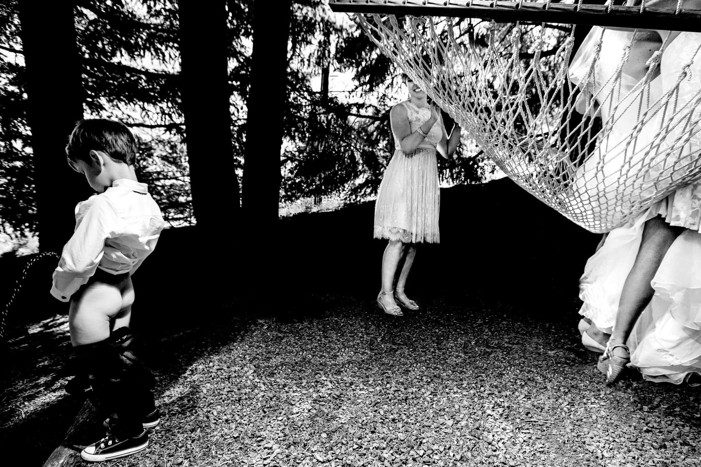 Award winning wedding humor photo of boy with bride at Gorge Crest.