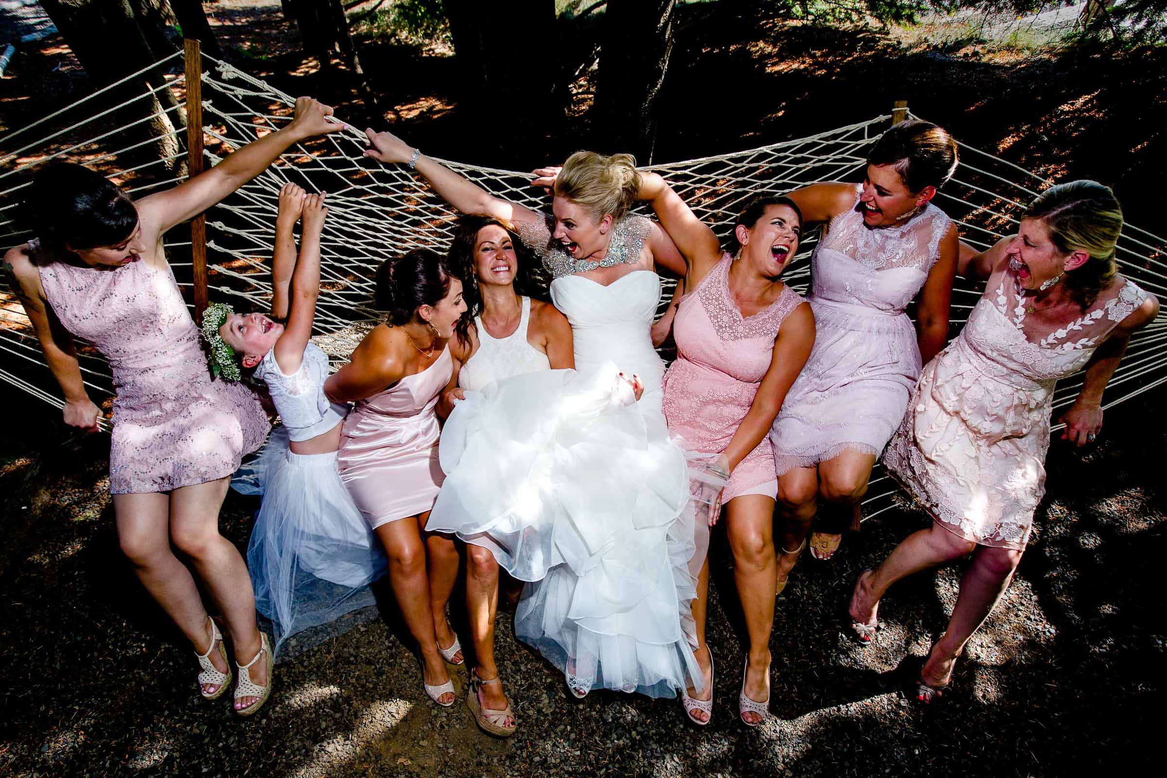 Bride and friends playing on a massive hammock at Gorge Crest wedding near Hood River in the Columbia Gorge just outside Portland in Oregon
