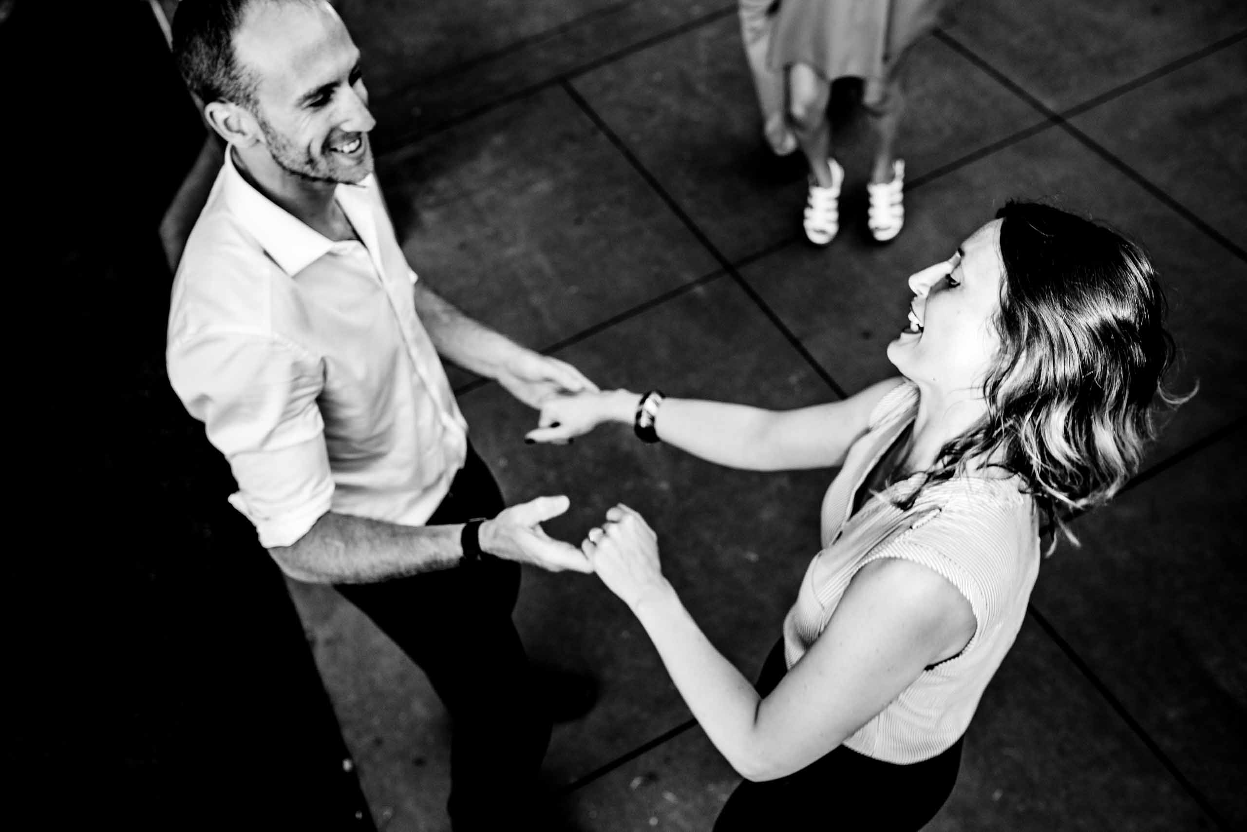 Guests dancing under beautiful market lights at Gorge Crest wedding venue in the Columbia River Gorge just outside Portland Oregon