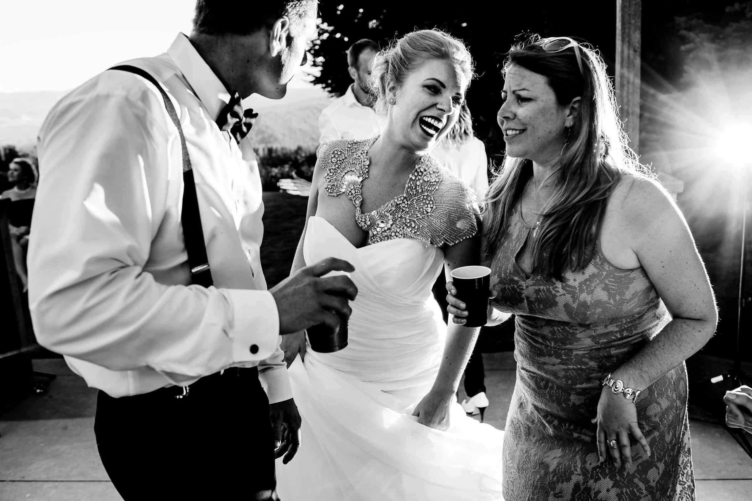 Bride dancing with friends under beautiful market lights at Gorge Crest wedding venue in the Columbia River Gorge just outside Portland Oregon