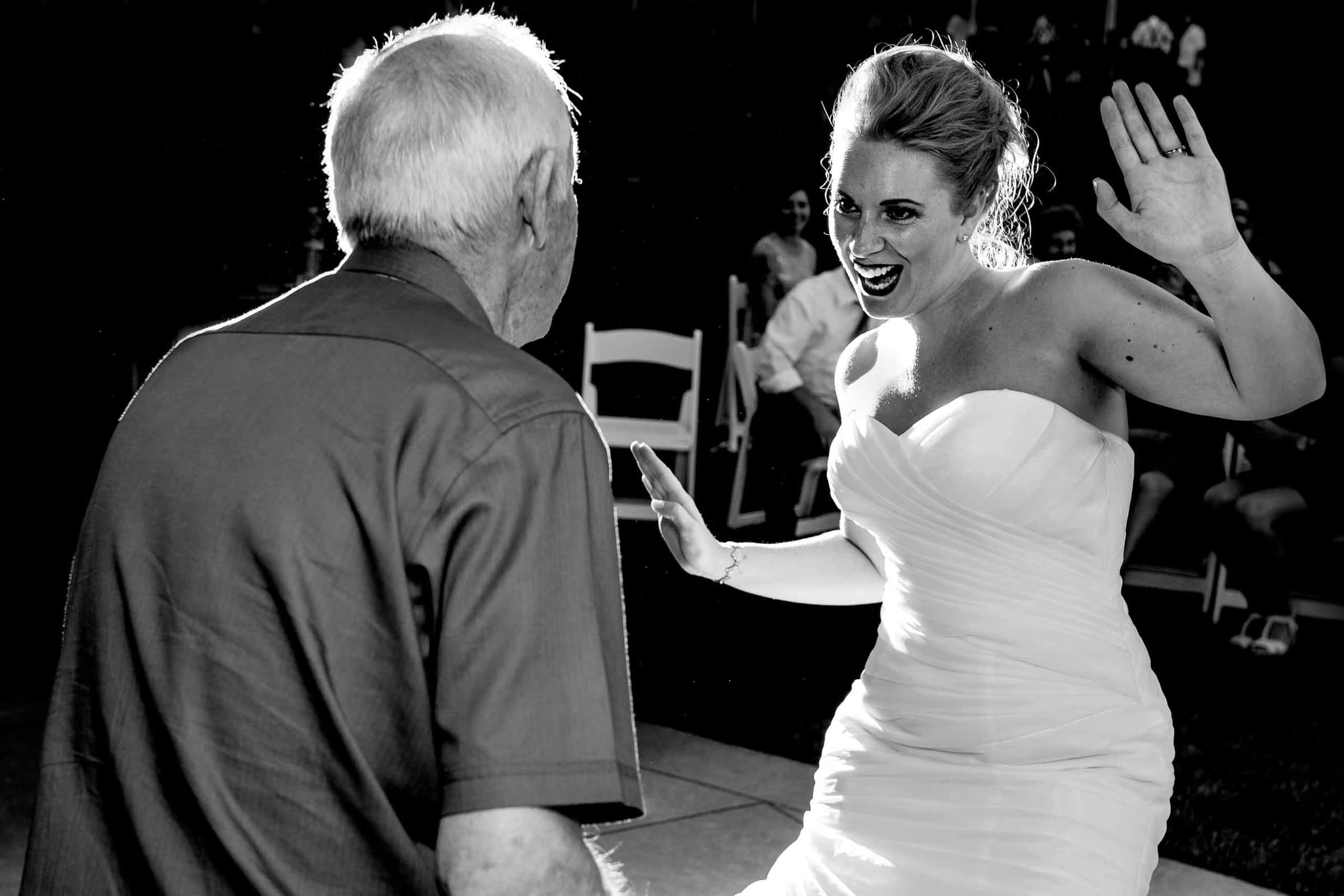Bride and father dancing under beautiful market lights at Gorge Crest wedding venue in the Columbia River Gorge just outside Portland Oregon