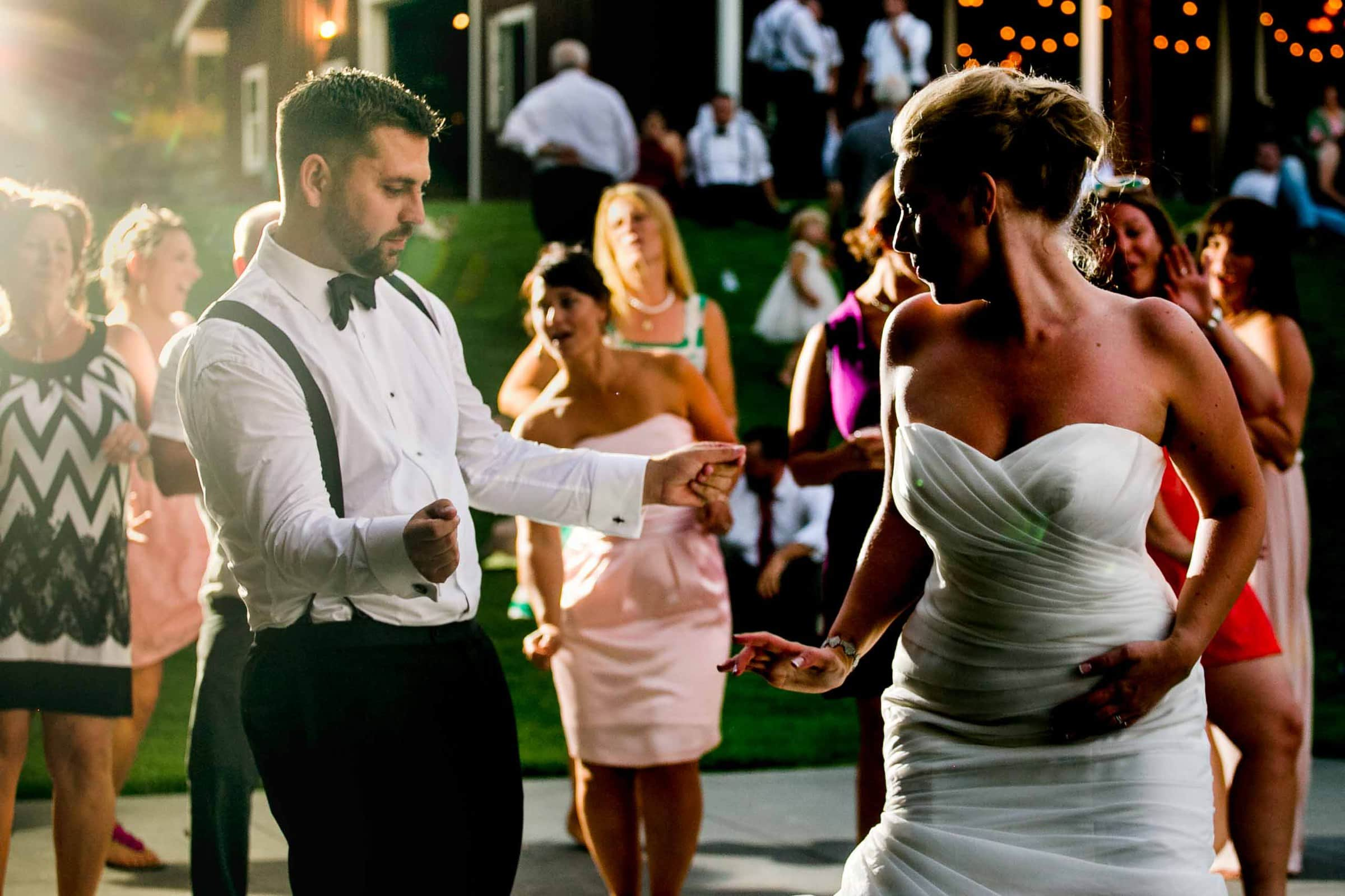 Bride and Groom dancing under beautiful market lights at Gorge Crest wedding venue in the Columbia River Gorge just outside Portland Oregon