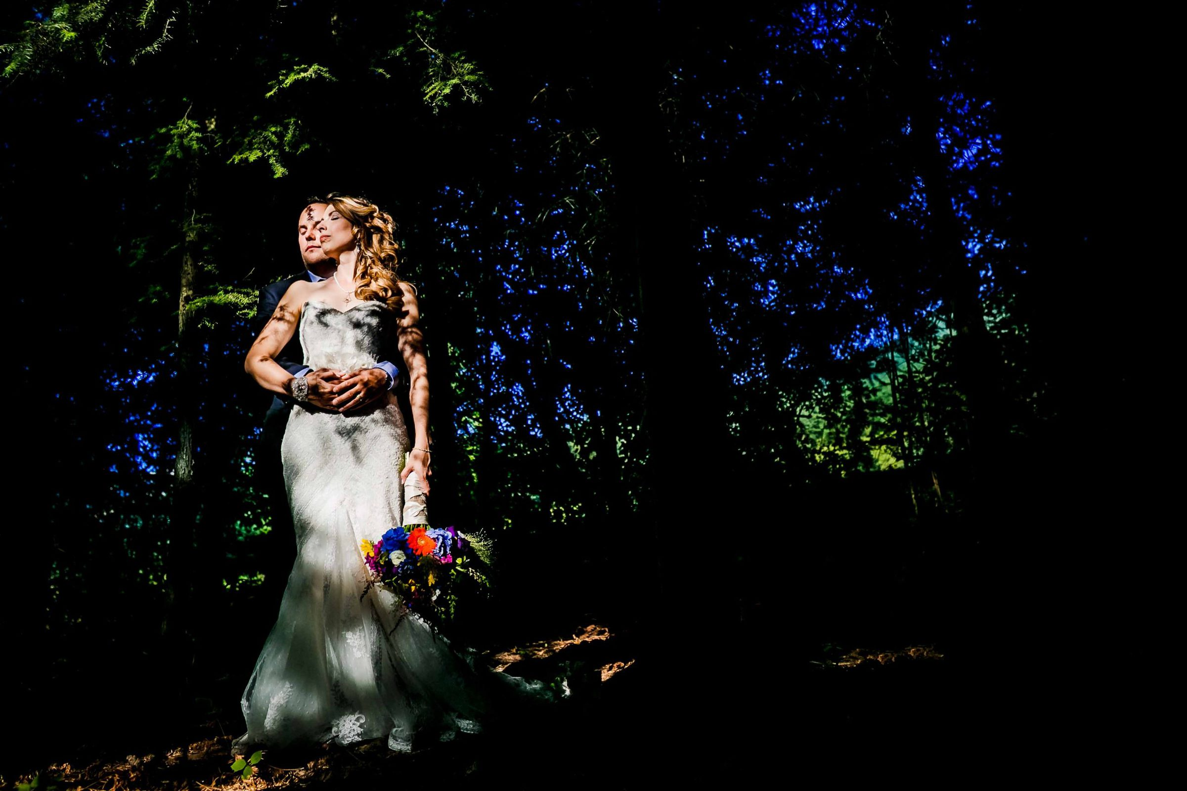 Dramatic photo of a bride and groom together in wooded trees moments after their Mt Hood Organic Farms wedding in Hood River, Oregon