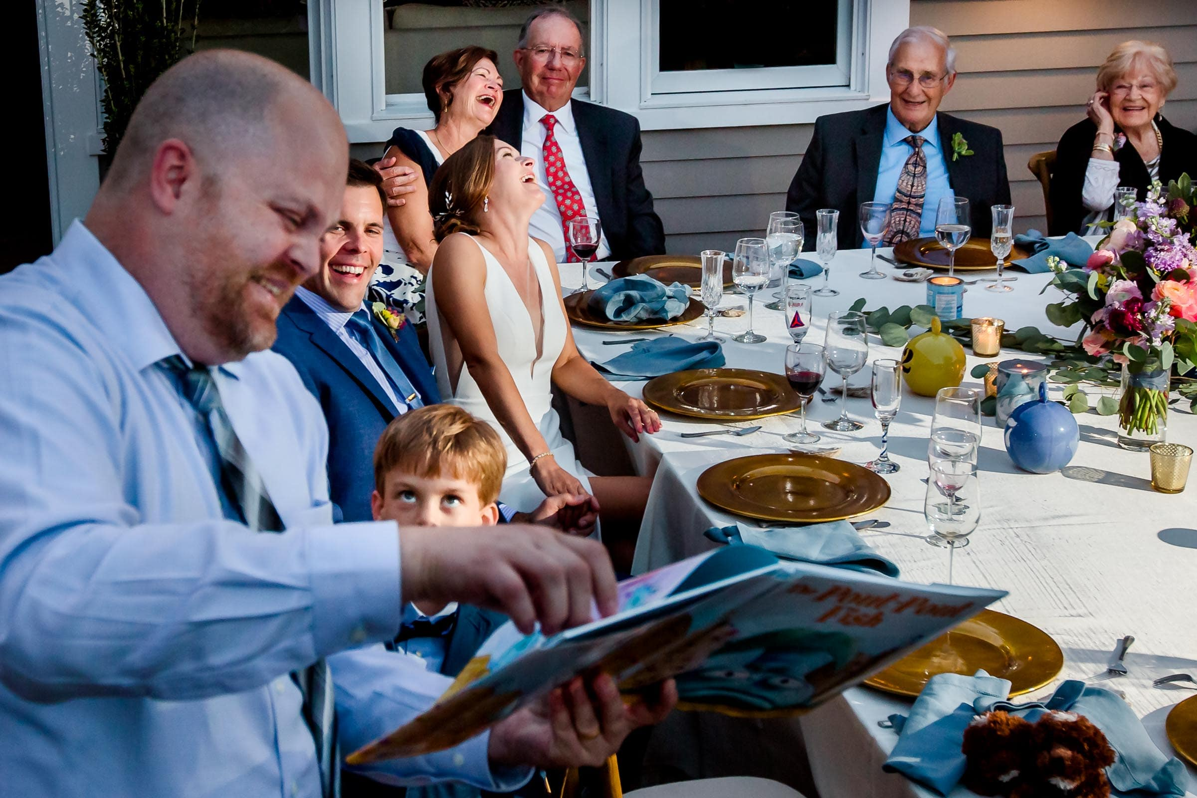 Humorous reception speech with everyone laughing together at Laura and GM's Chesapeake Bay wedding