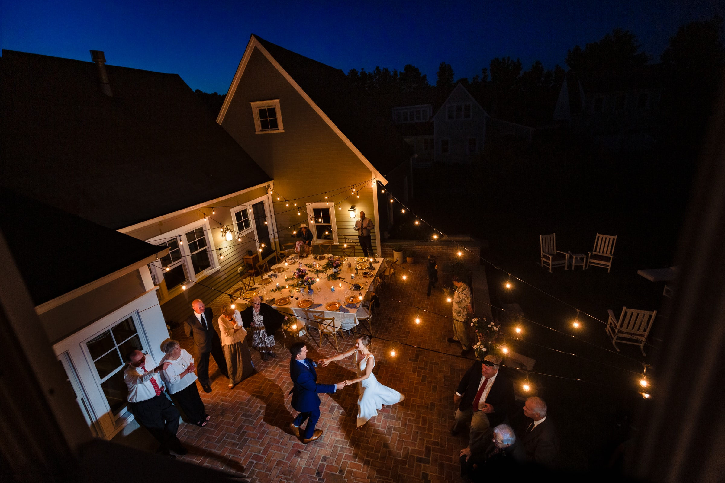 Gorgeous action shot of bride and groom dancing in an outdoor backyard wedding for their Chesapeake Bay Wedding.