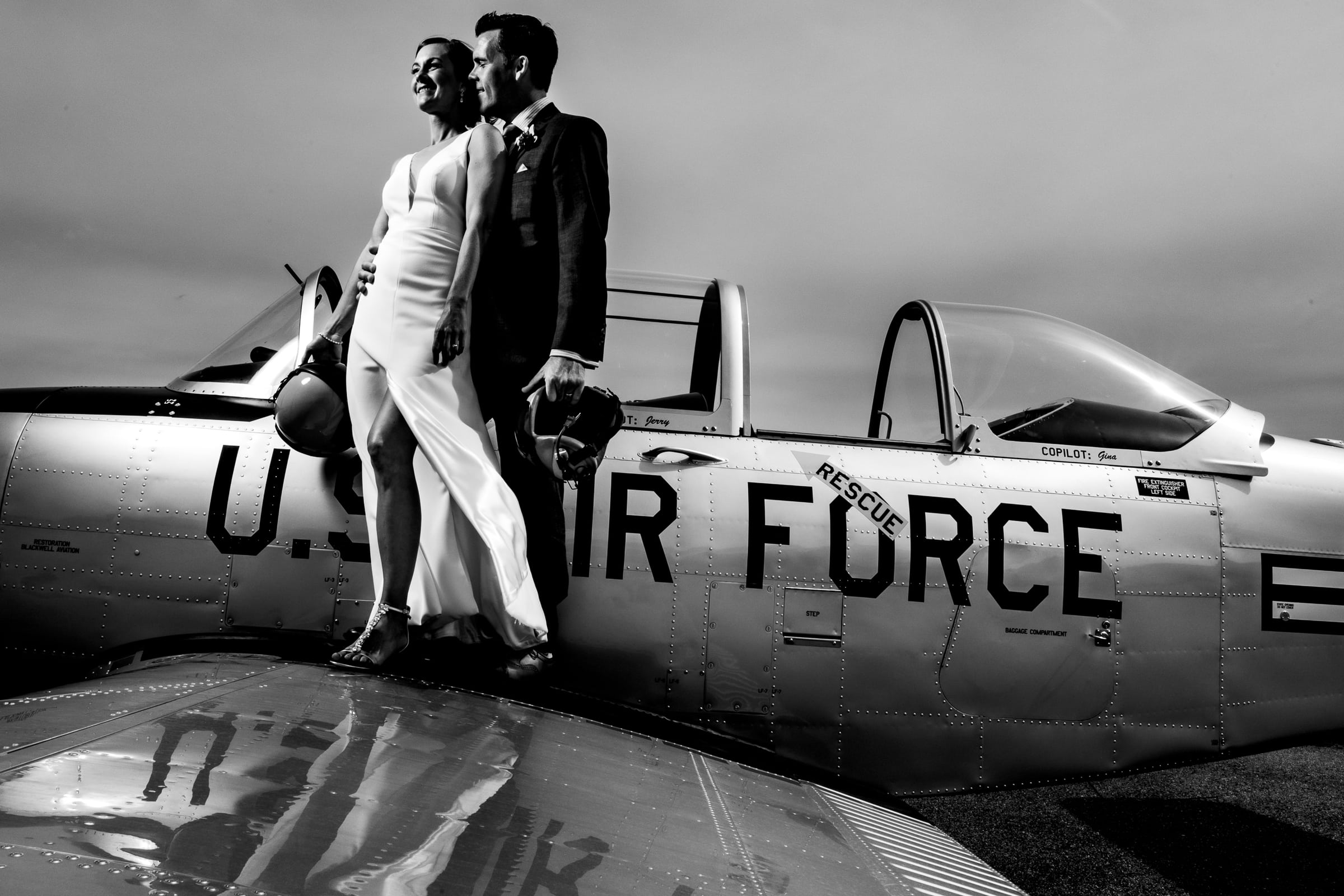 Bride and groom portrait on a US Air Force plane at their Chesapeake Bay wedding, Maryland.