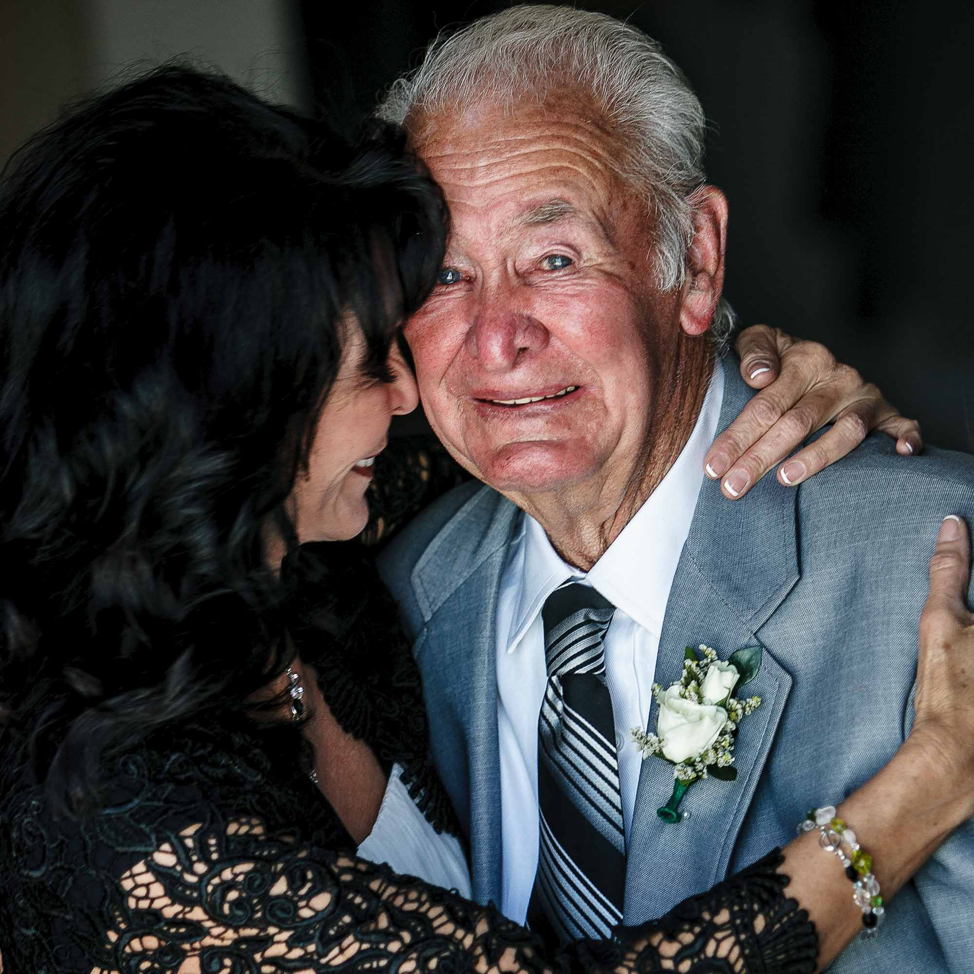 emotional photo of grandfather with bride before entering ceremony