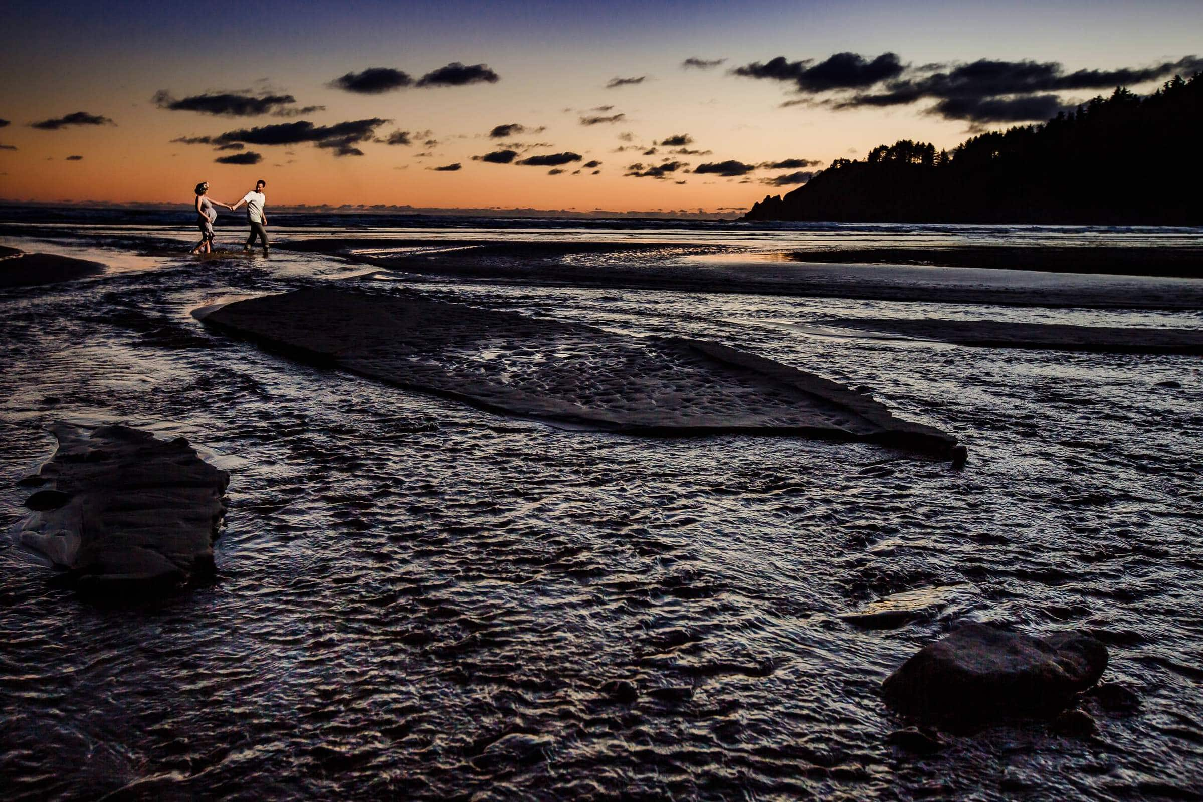 Gorgeous sunset photo of couple walking on beach for their maternity photos at Oswald West on Short Sands Beach
