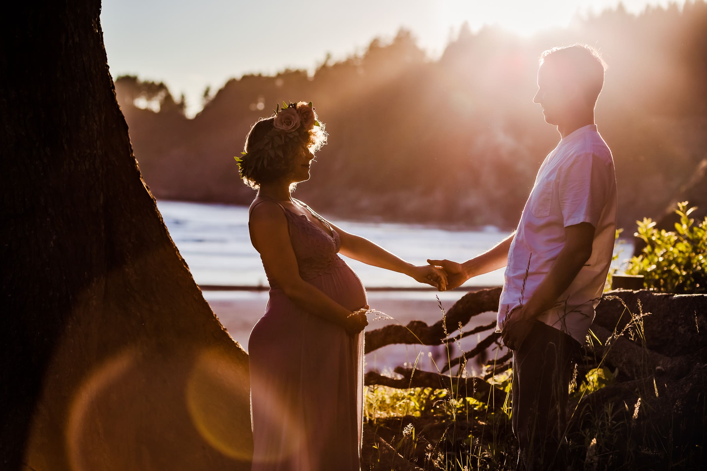 Pregnant couple in gorgeous soft sunlight for their maternity photos at Oregon Coast