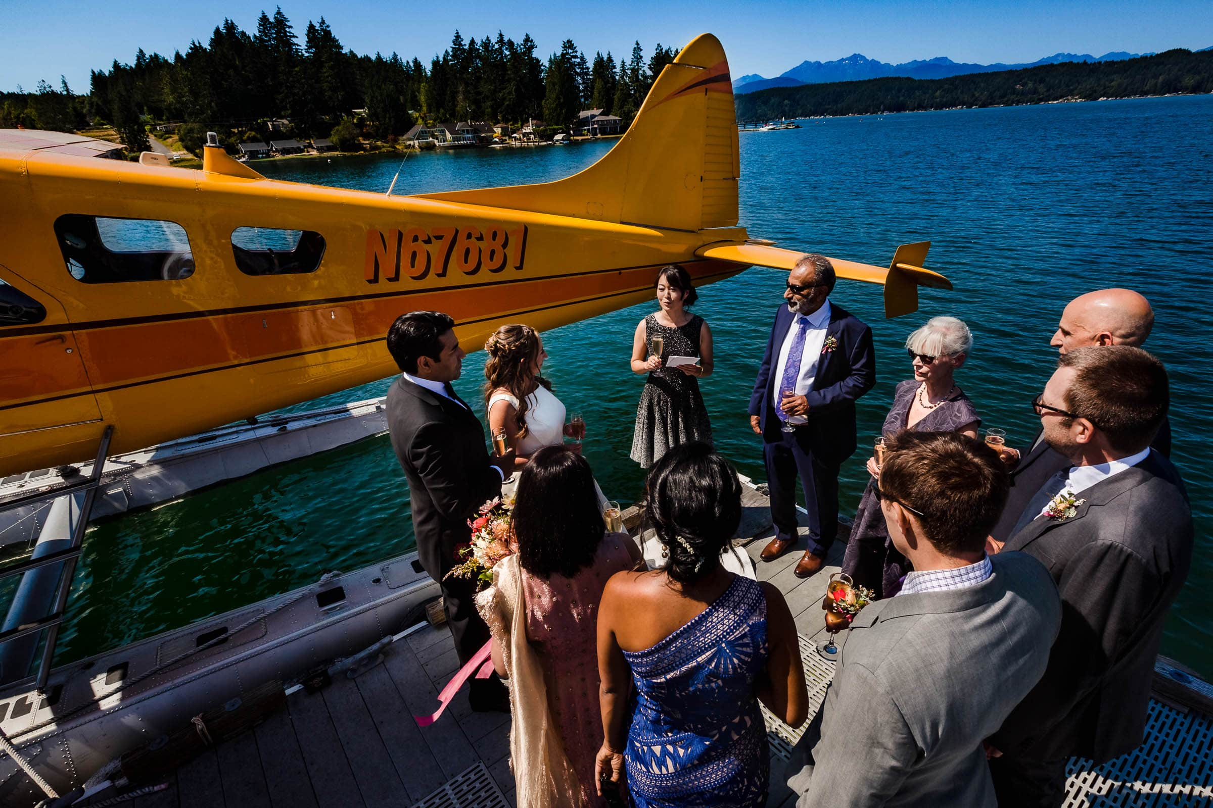 Family and friends gathering around seaplane for an Alderbrook elopement and champagne toast send off to Hope Island.