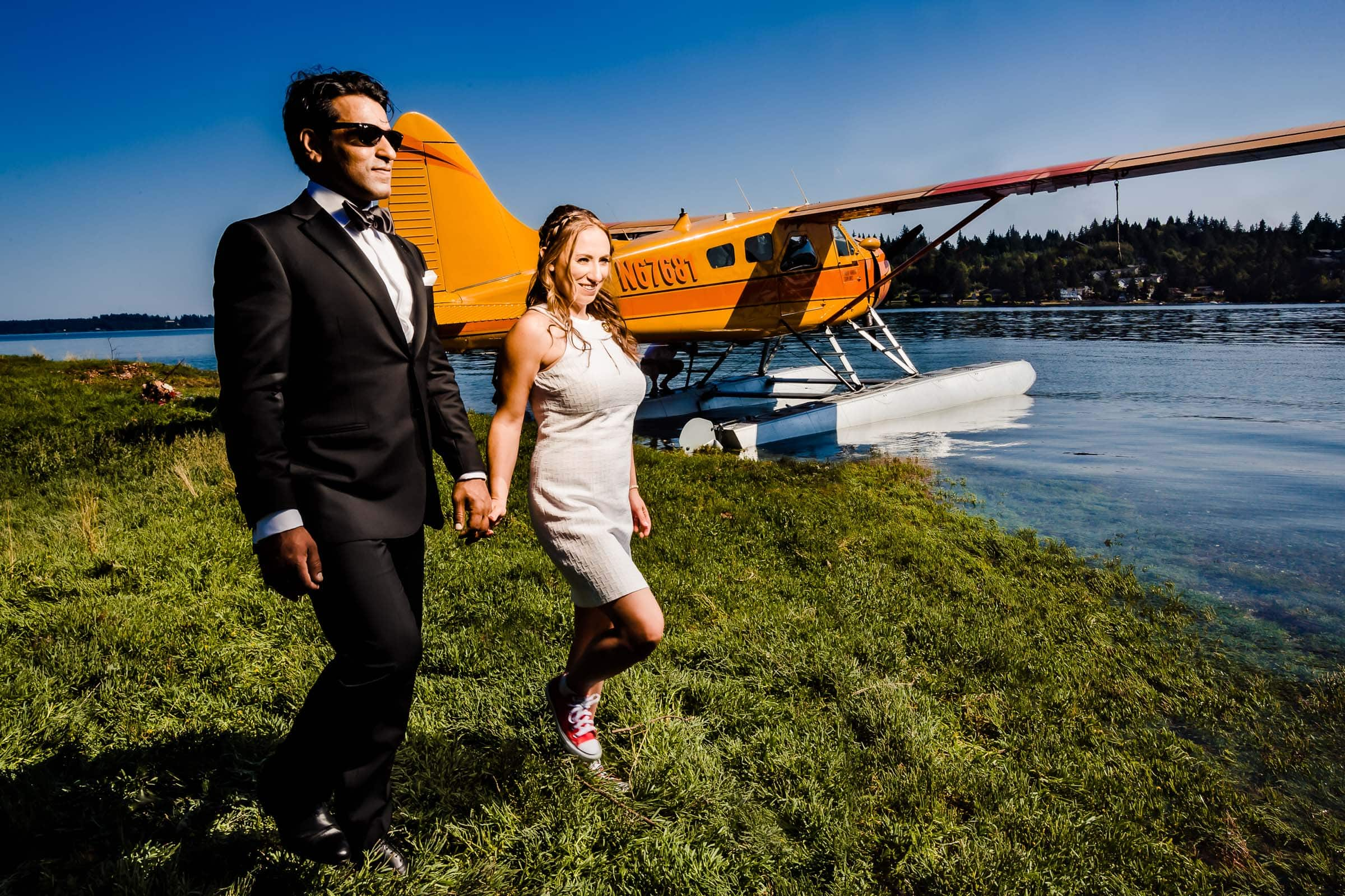 Bride and Groom walking on Hope Island together with a seaplane for their Alderbrook Elopement.