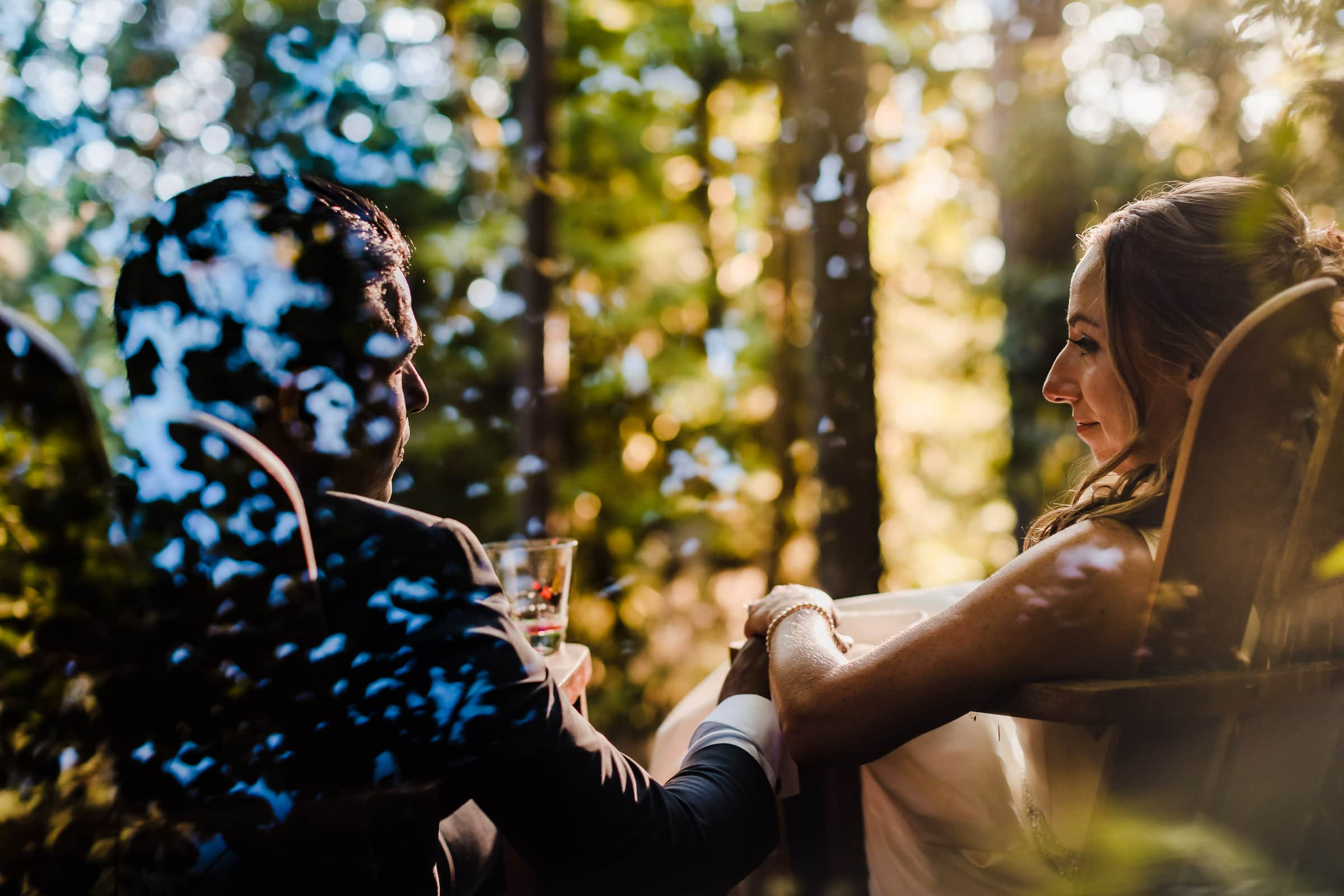 Bride and groom enjoying a moment at the Gathering Grove during their Alderbrook Elopement