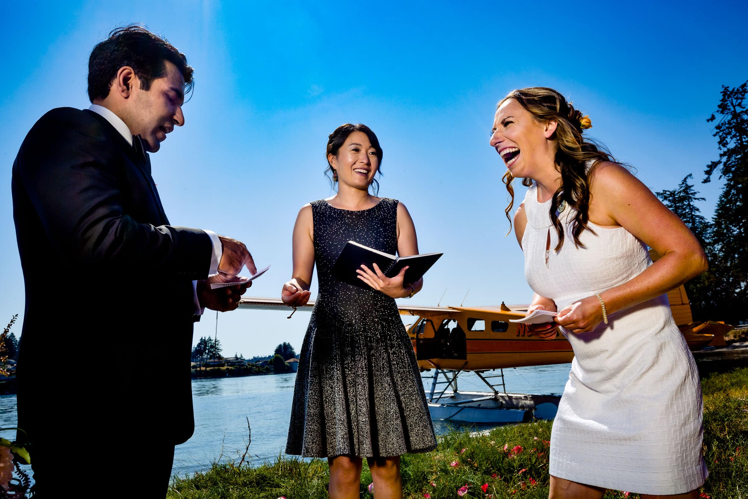 Bride laughing during ceremony at their Alderbrook elopement