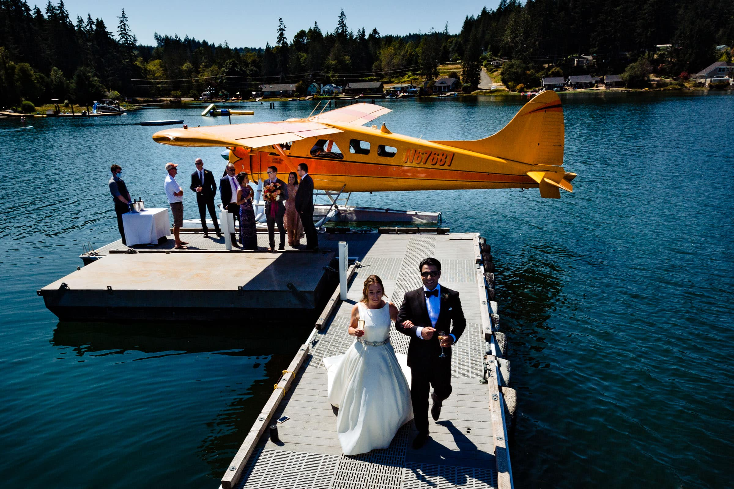 Bride and groom walking down dock for their Alderbrook elopement before heading out on a seaplane to Hope Island for their ceremony