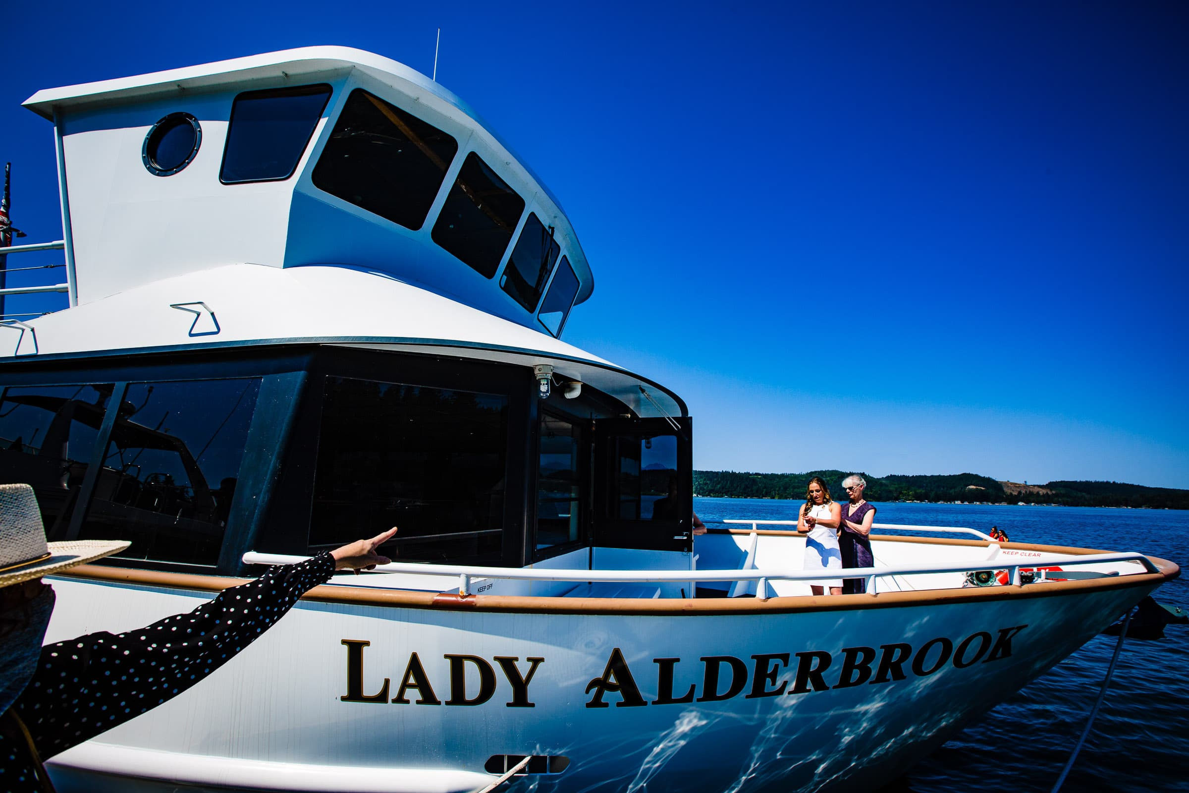 Bride getting ready at Alderbrook on the ferry boat for her Alderbrook Elopement