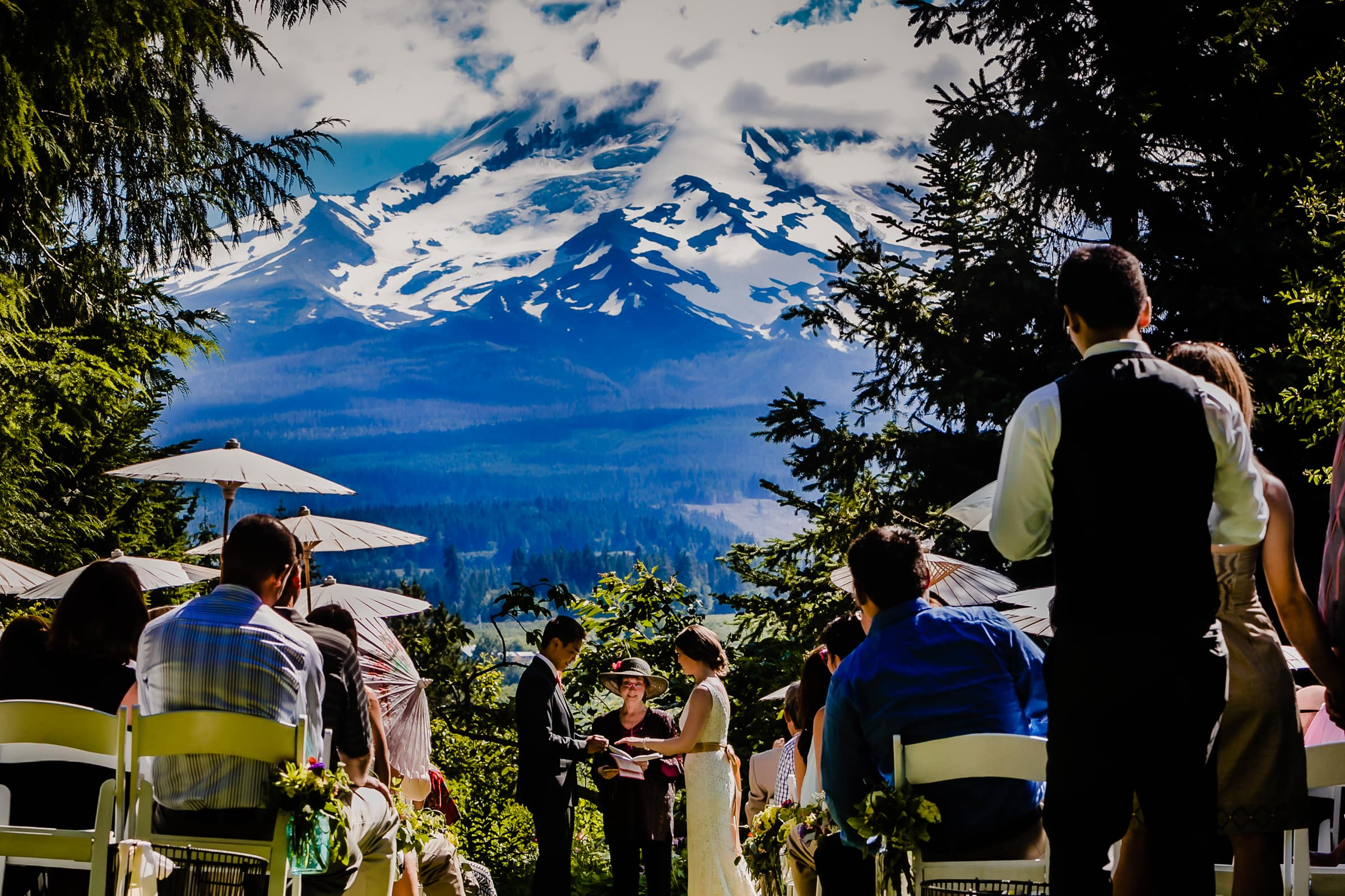 Bride and groom exchanging vows during their Mt Hood Organic Farms Wedding ceremony
