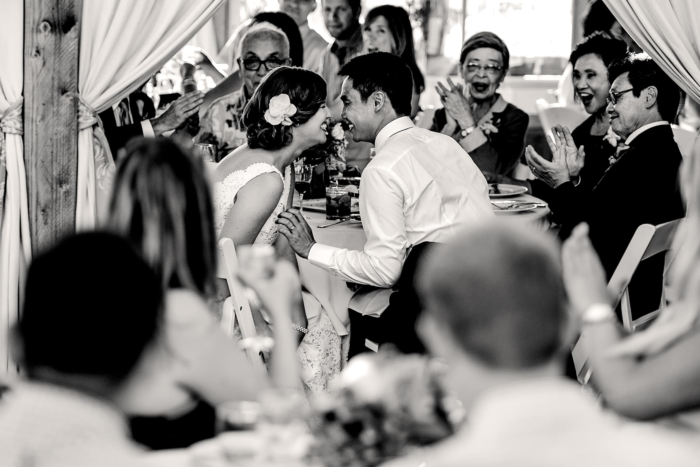 Bride and groom enjoying family and friends cheering them on during their Mt Hood Organic Farms wedding reception