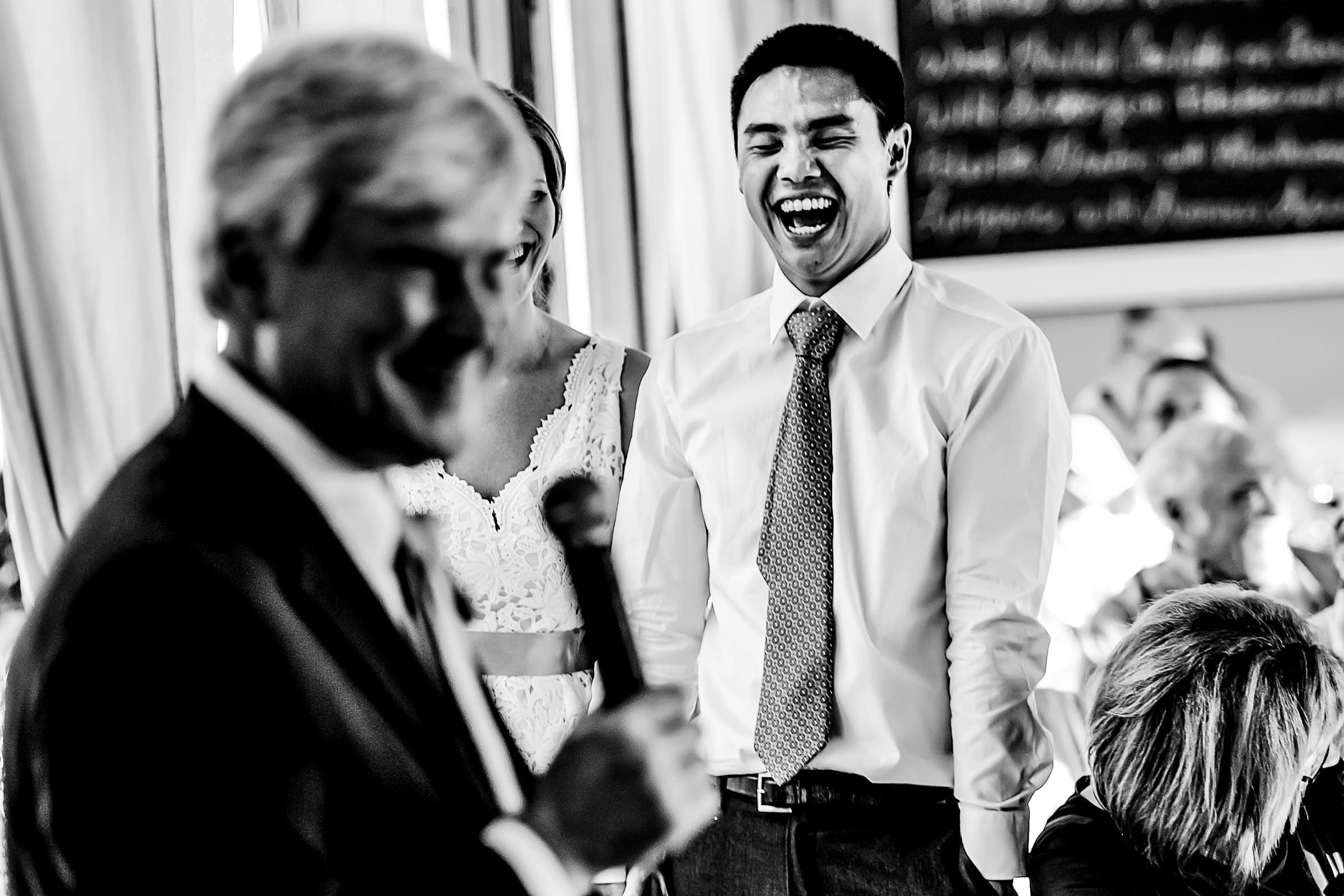 Fathers comical speech to groom laughing during a Mt Hood Organic Farms wedding reception