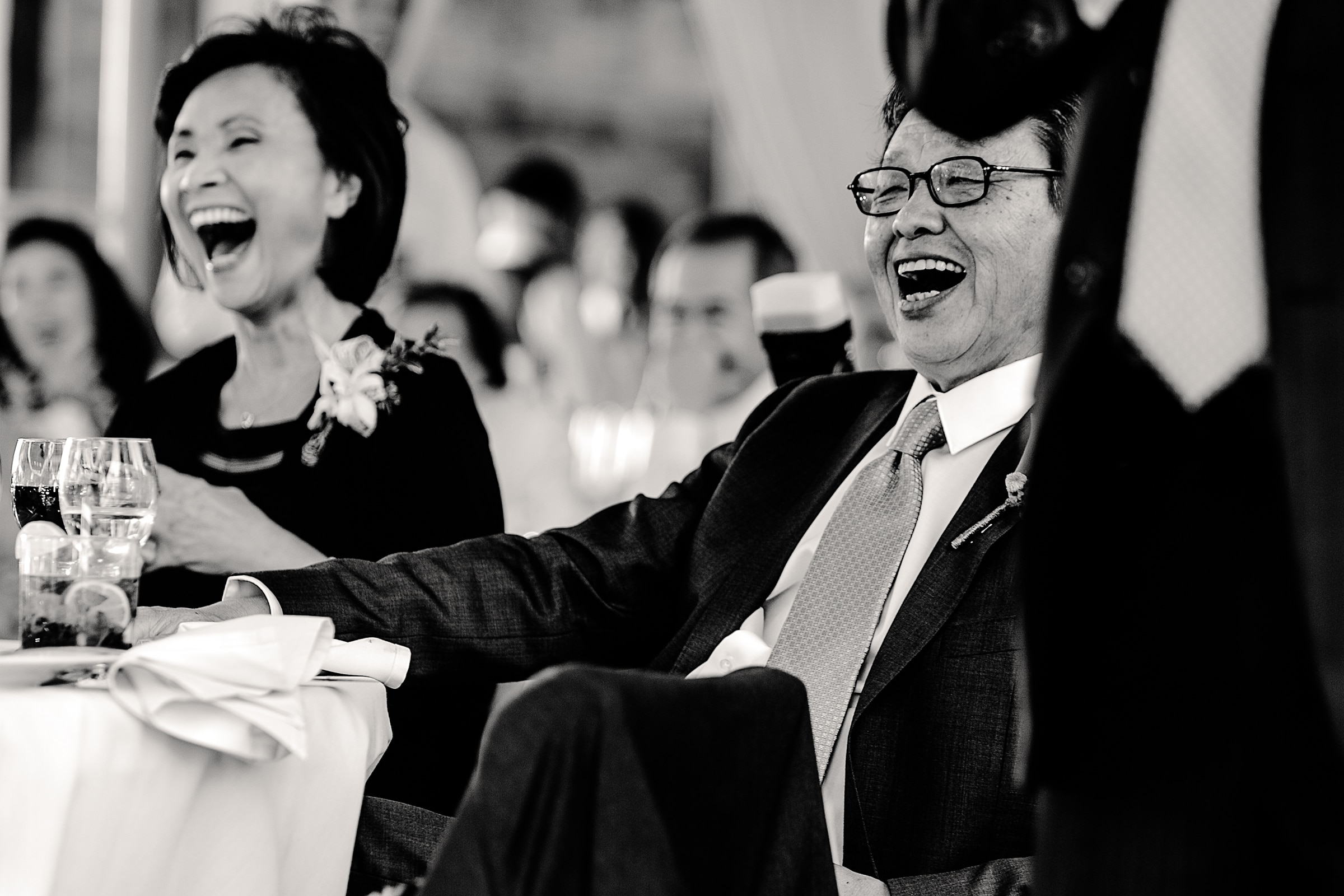 Parents laughing during speeches at a Mt Hood Organic Farms wedding reception